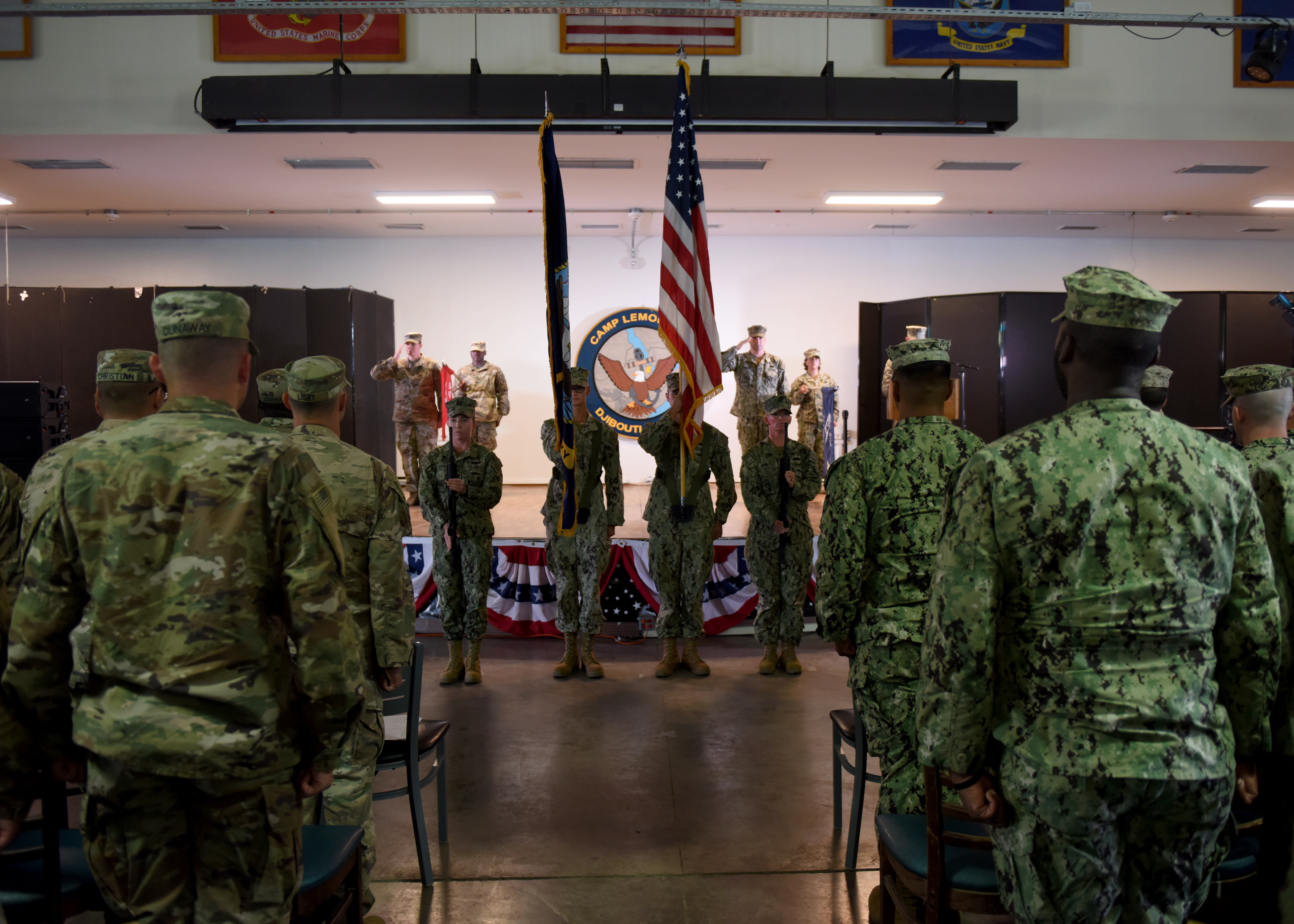U.S. Navy Seabees from Naval Mobile Construction Battalion (NMCB) 1, assigned to Combined Joint Task Force-Horn of Africa (CJTF-HOA), present the colors during a transfer-of-authority ceremony at Camp Lemonnier, Djibouti, Feb. 11, 2019. The NMCB 1 transferred authority of building and improving facilities on base and in the combined joint operations area and area of interest to the U.S. Army 465th Engineer Company, 926th Engineer Battalion, 926th Engineer Brigade, 412th Theater Engineer Command, based in Birmingham, Alabama, assigned to CJTF-HOA. (U.S. Air Force photo by Staff Sgt. Franklin R. Ramos)