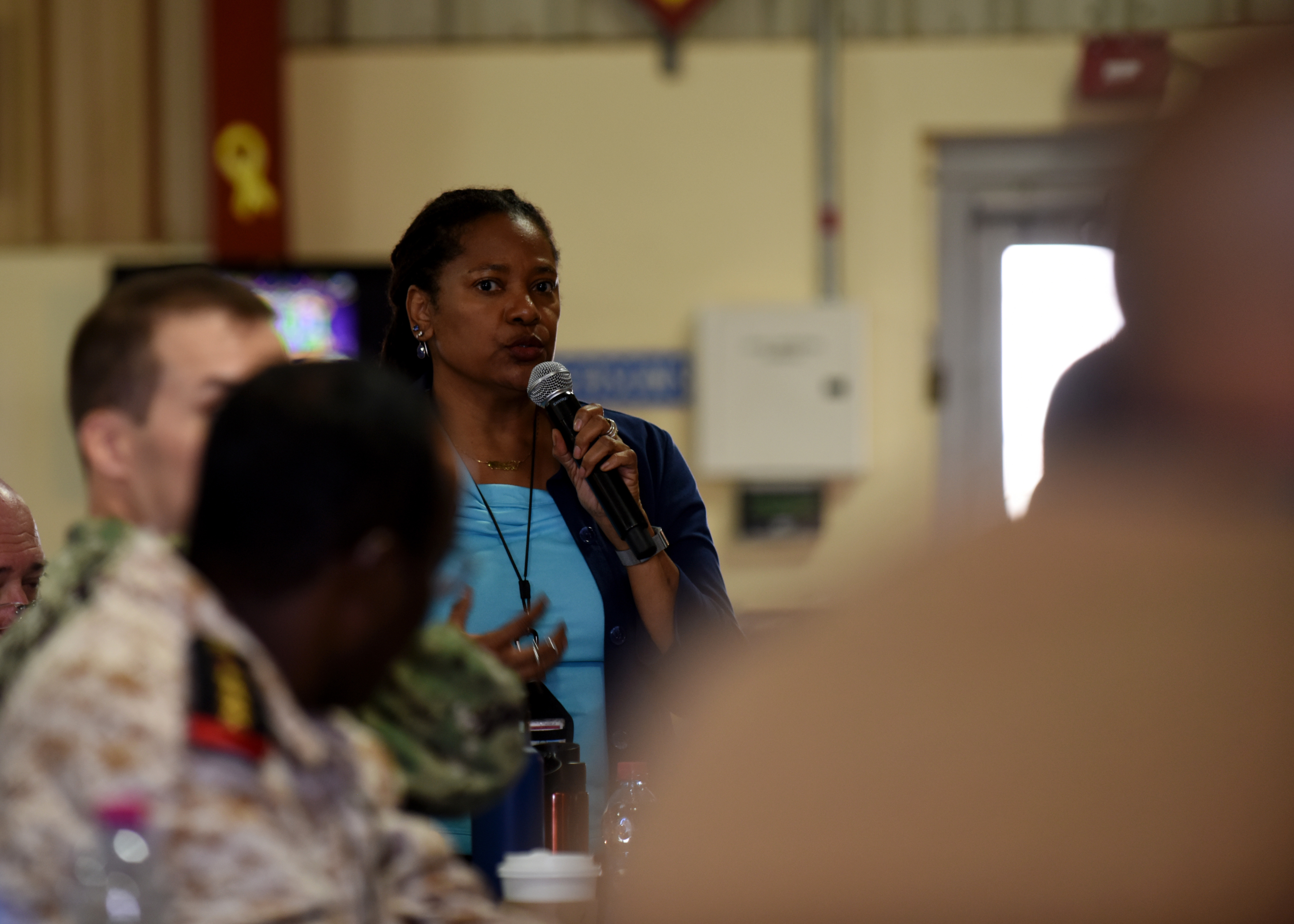 Rabihah Mateen, U.S. Agency International Development country representative for Djibouti, speaks during an Emergency Response Information Exchange multinational discussion, Feb. 12, 2019 at Camp Lemonnier, Djibouti. The three-day discussion included representatives from the U.S., Japan, Germany, Italy, France, Spain and Djibouti, who identified various capabilities each nation can offer during the event of a natural disaster in Djibouti, including communication equipment, emergency vehicles and medical support. (U.S. Air Force photo by Staff Sgt. Franklin R. Ramos)
