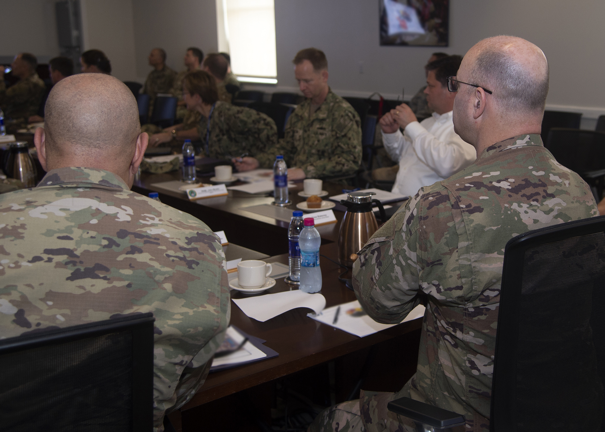 U.S. Air Force Brig. Gen. James R. Kriesel, deputy commanding general of Combined Joint Task Force-Horn of Africa, watches a slide show during a classroom session as part of the Capstone Military Leadership Program at Camp Lemonnier, Djibouti, Feb. 13, 2019. Capstone is a joint-service professional military education course for newly-promoted brigadier generals and rear admirals serving in the U.S. military. (U.S. Navy photo by Mass Communication Specialist 1st Class Nick Scott)
