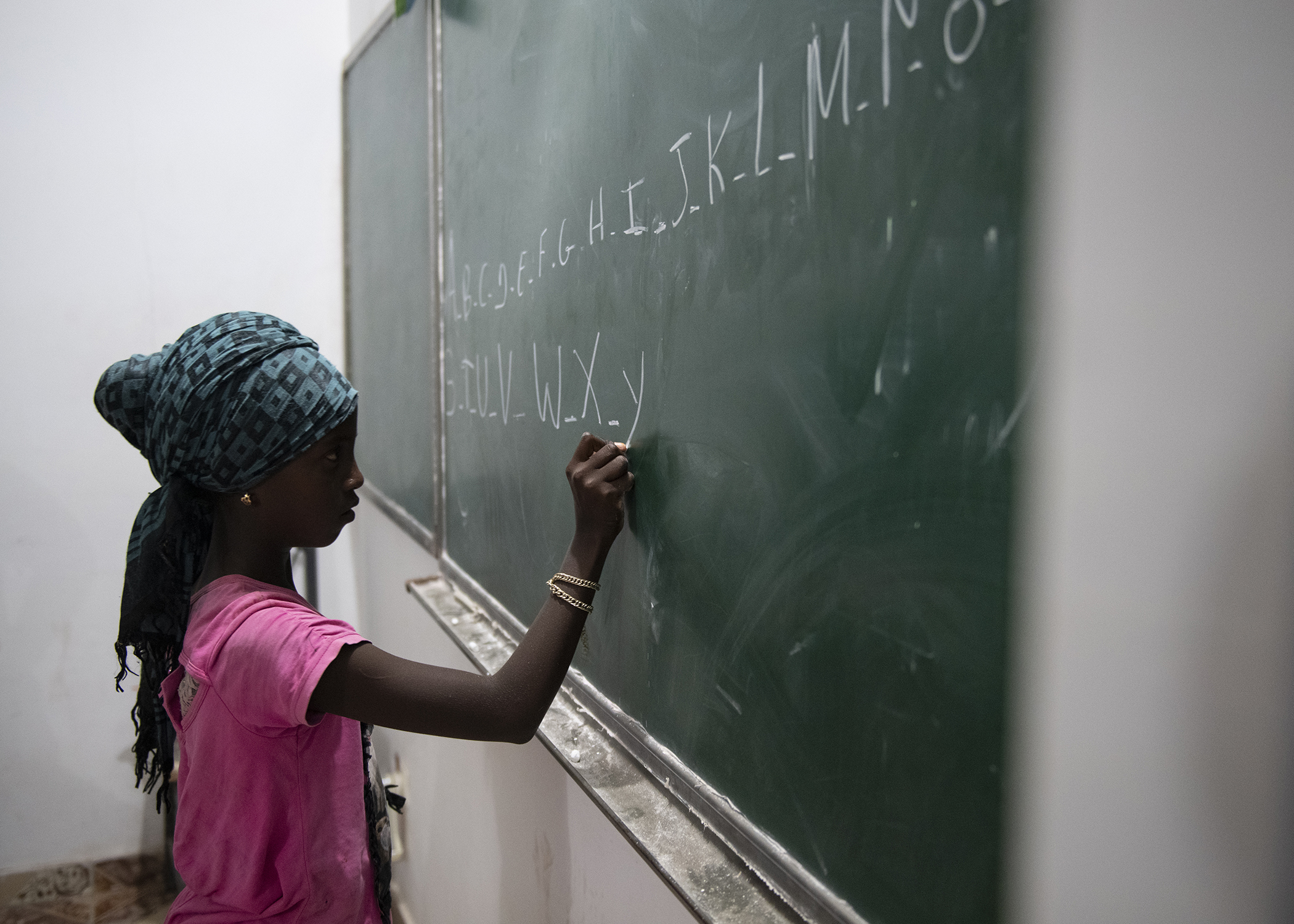 A child writes the alphabet during an English Discussion Group led by U.S. Army Soldiers from the 404th Civil Affairs Battalion, assigned to Combined Joint Task Force-Horn of Africa, in Tadjourah, Djibouti, Feb. 12, 2019. More than 90 Djiboutian youth and adults attended the group where students develop practical linguistic and rhetorical skills through conversation with English-speaking U.S. service members. (U.S. Air Force photo by Tech. Sgt. Shawn Nickel)