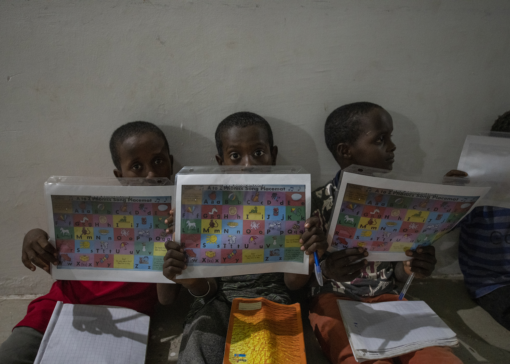 Children use reading aids during an English Discussion Group led by U.S. Army Soldiers from Bravo Company, 404th Civil Affairs Battalion, assigned to Combined Joint Task Force-Horn of Africa, in Tadjourah, Djibouti, Feb. 12, 2019. More than 90 Djiboutian youth and adults attended the group where students develop practical linguistic and rhetorical skills through conversation with English-speaking U.S. service members. (U.S. Air Force photo by Tech. Sgt. Shawn Nickel)