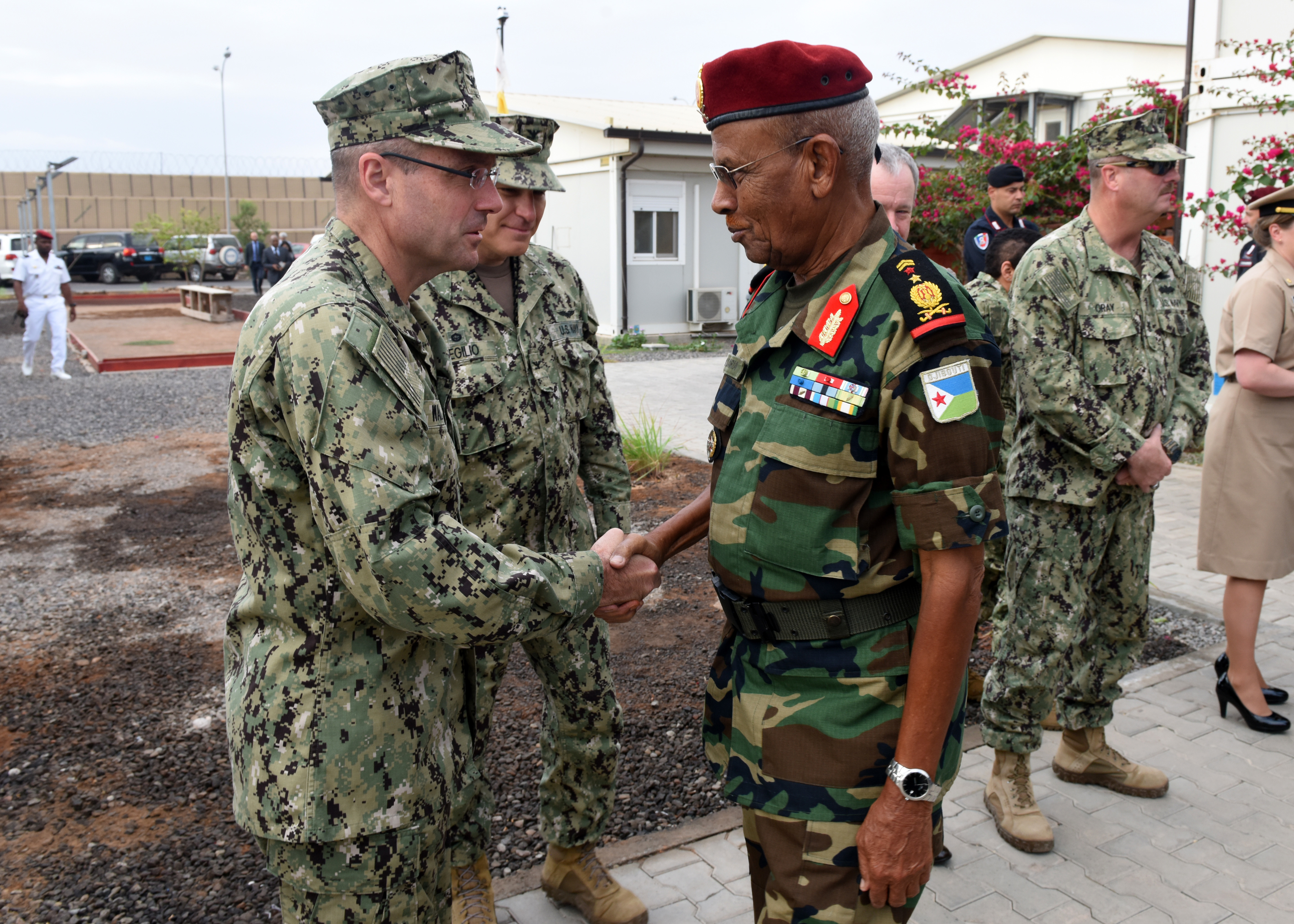 U.S. Navy Capt. Thomas Wall, chief of staff of Combined Joint Task Force-Horn of Africa,  greets Djiboutian army Gen. Zakaria Cheikh Ibrahim, chief of defense of Djibouti Armed Forces, during an anniversary ceremony at the Italian National Military Support Base, Djibouti, Feb. 19, 2019. Wall attended the ceremony, which celebrated the Italian base's fifth year in Djibouti, to show support for U.S. partner and coalition forces. (U.S. Air Force photo by Staff Sgt. Franklin R. Ramos)