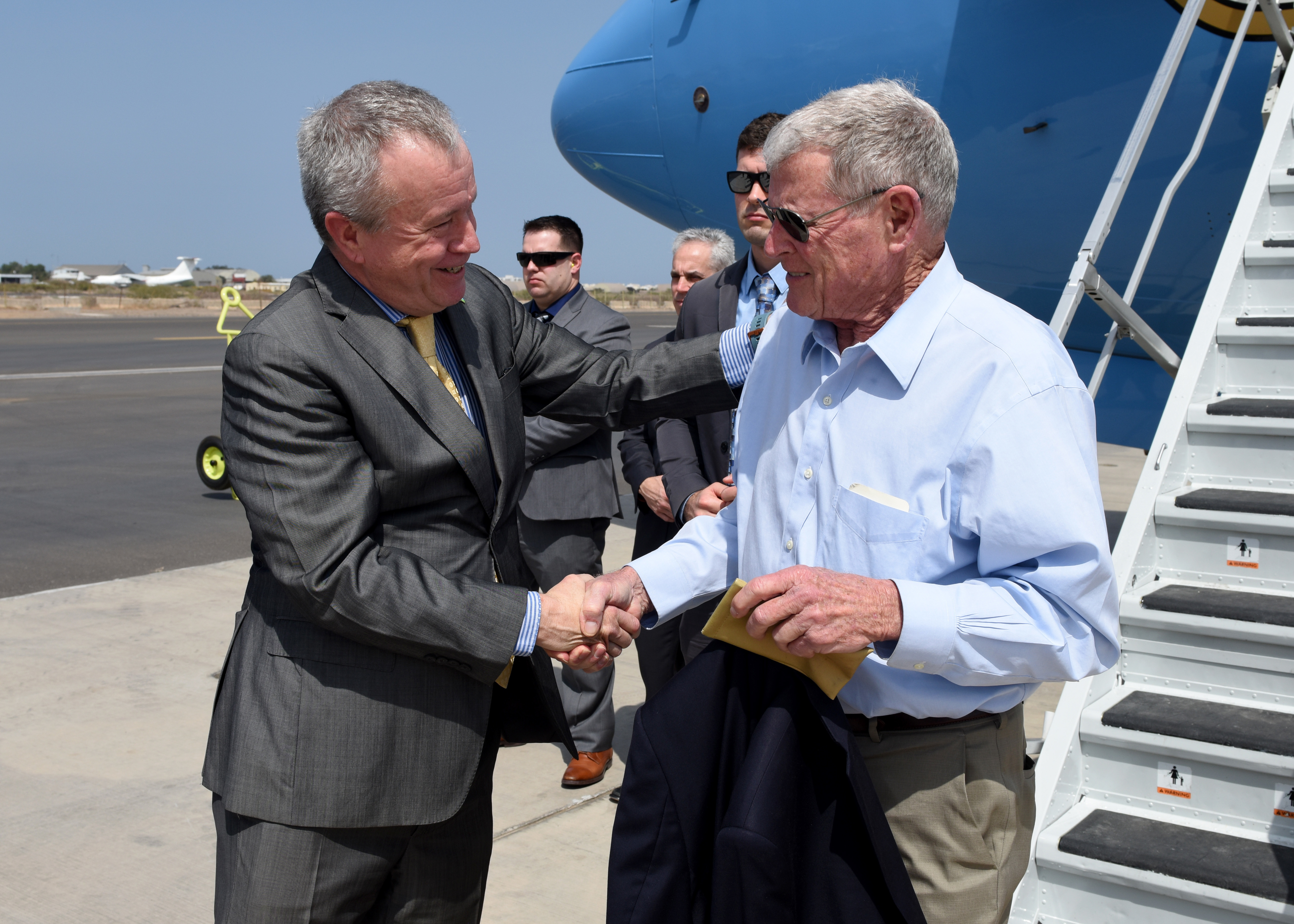 U.S. Ambassador to Djibouti Larry Andre' greets U.S. Sen. James Inhofe (R-Okla.) during a visit to Camp Lemonnier, Djibouti, Feb. 20, 2019. Inhofe visited Djibouti to meet with U.S. forces and embassy officials to gain an insight on the current posture within the combined joint operations area. (U.S. Air Force Photo by Staff Sgt. Franklin R. Ramos)