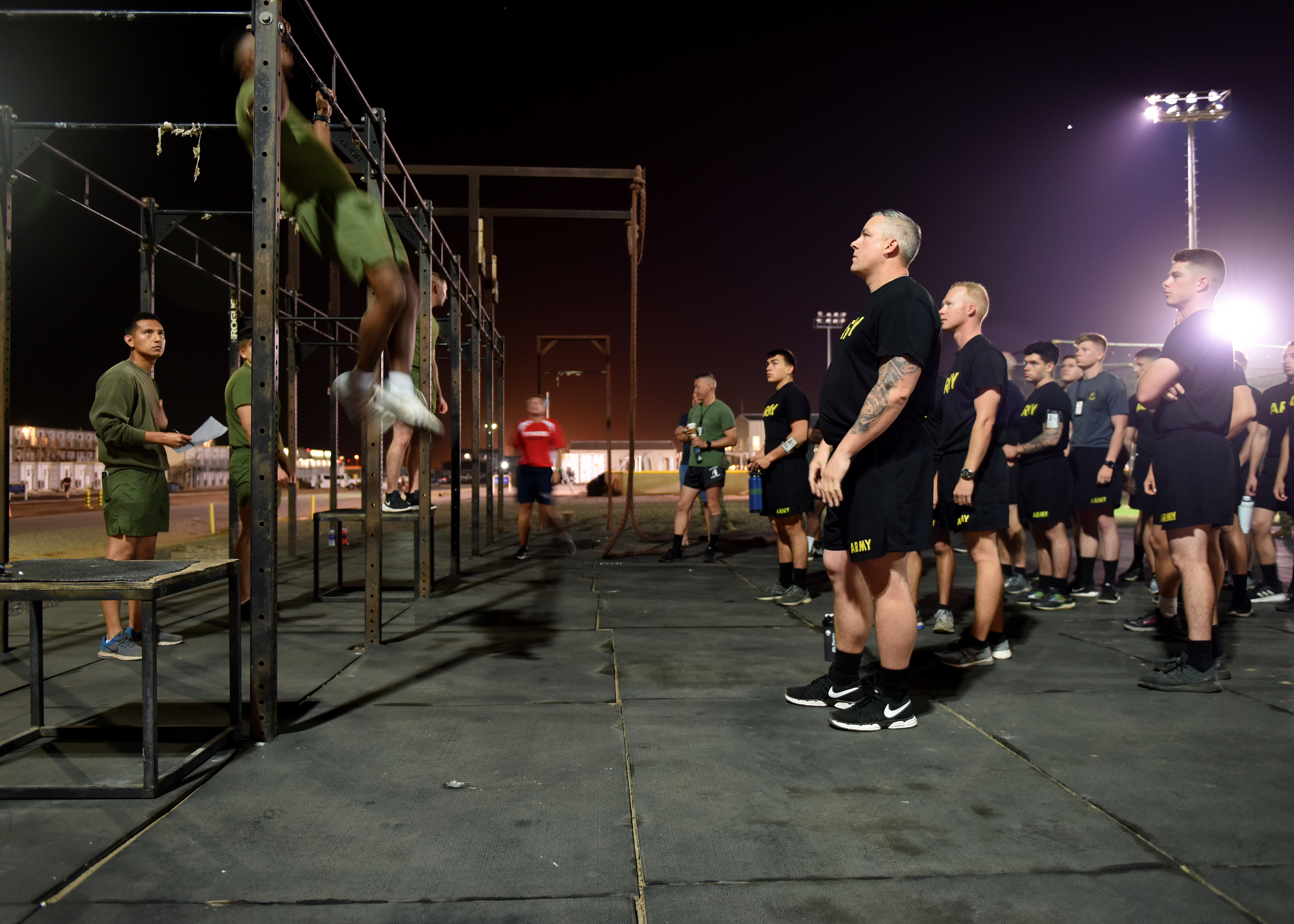 U.S. Marines assigned to Combined Joint Task Force-Horn of Africa (CJTF-HOA) demonstrate pull-ups during the joint fitness test portion of the Joint Warrior Competition at Camp Lemonnier, Djibouti, Feb. 26, 2019. U.S. service members assigned to CJTF-HOA and Camp Lemonnier participated in the fitness test, which consisted of components of each services' physical fitness exams to include Marine pull-ups. (U.S. Air Force Photo by Staff Sgt. Franklin R. Ramos)