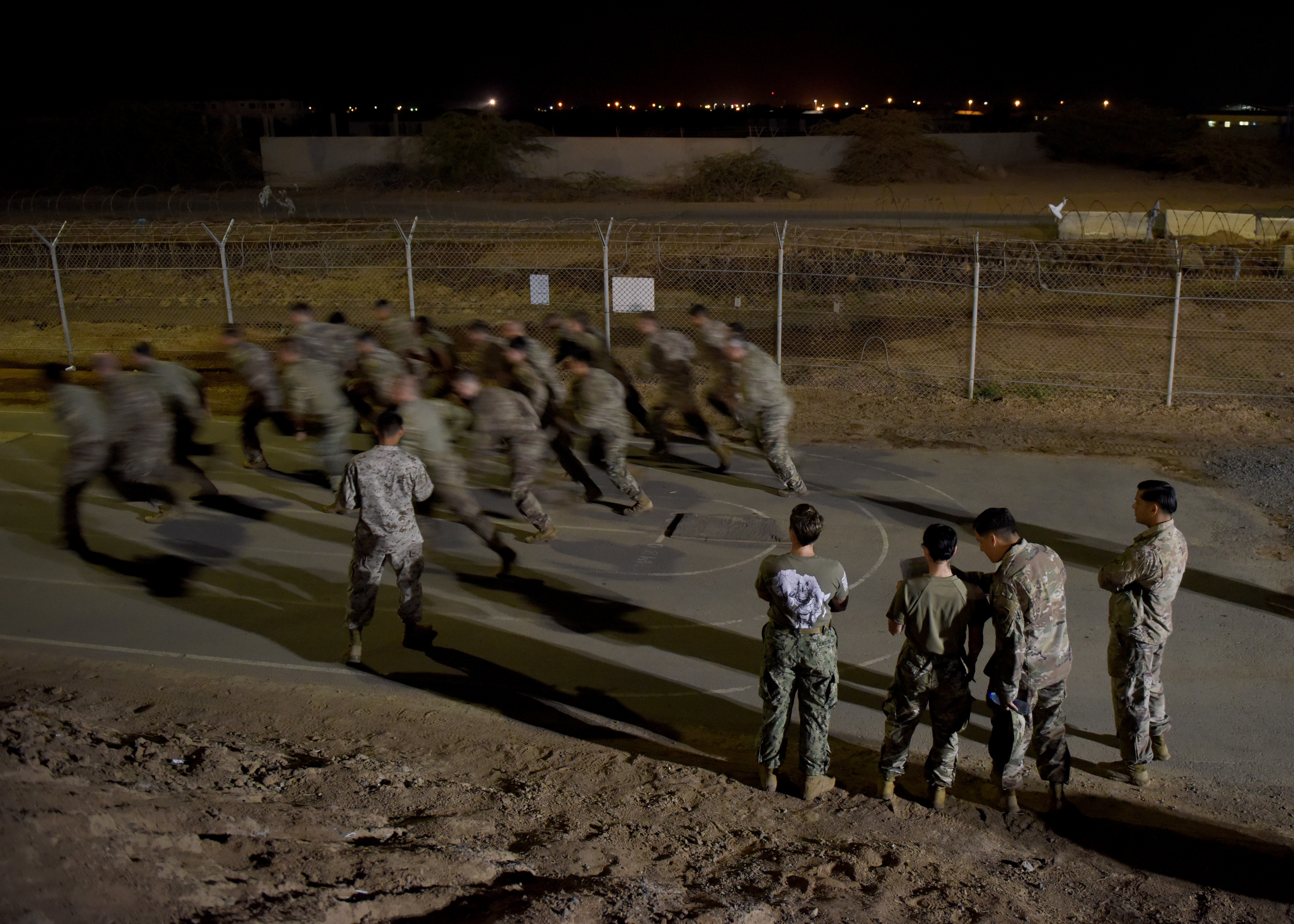 U.S. Army Soldiers, assigned to Combined Joint Task Force-Horn of Africa (CJTF-HOA), start the U.S. Marine Corps combat fitness test (CFT) portion of the Joint Warrior Competition at Camp Lemonnier, Djibouti, March 1, 2019. The CFT, which consisted of an 880-meter run, 2-minute ammo can lift and a maneuver under fire course, was part of the four-day competition that was open to U.S. service members assigned to CJTF-HOA and Camp Lemonnier. (U.S. Air Force Photo by Staff Sgt. Franklin R. Ramos)