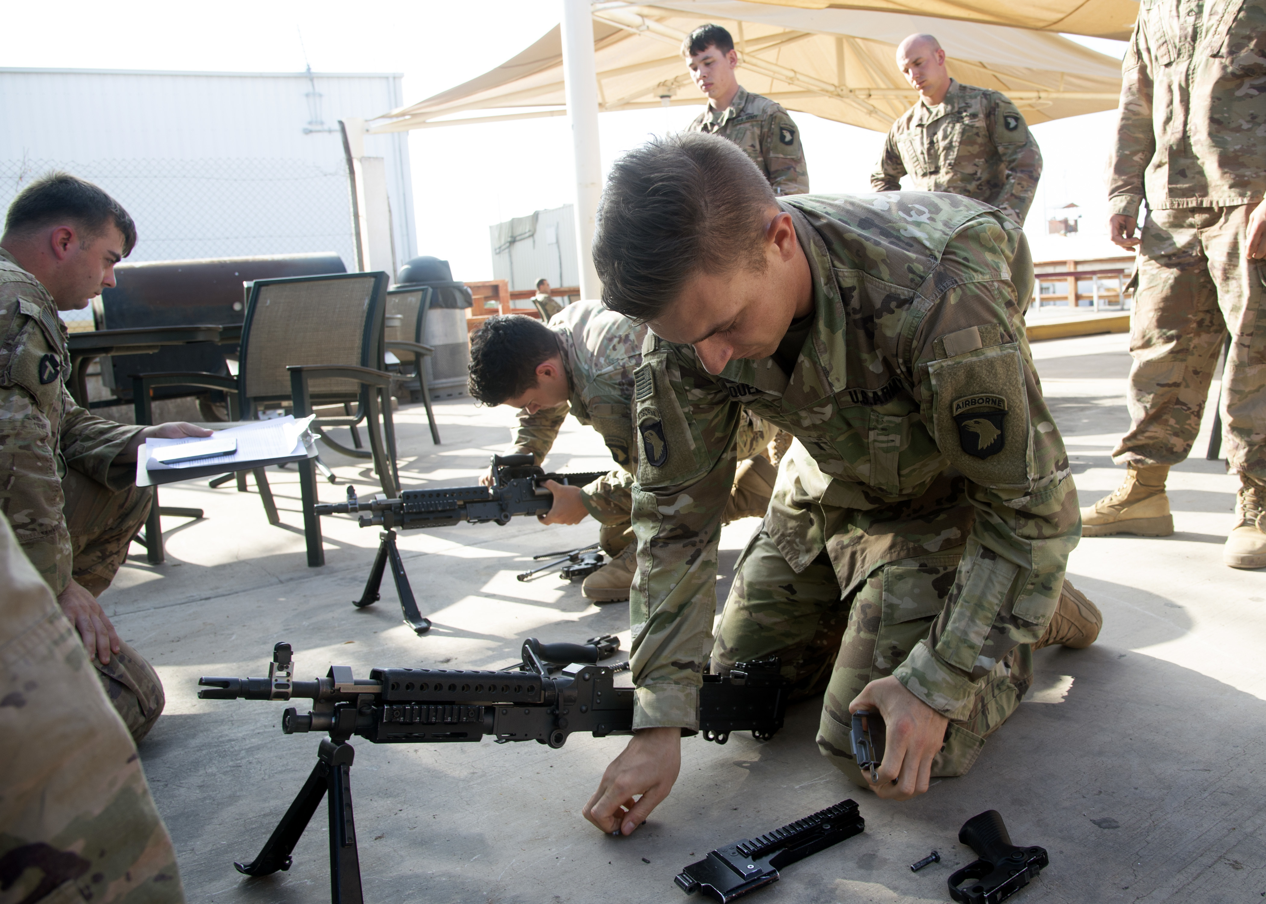 U.S. Army 1st Lt. Anthony Mosqueda, a Soldier from Bravo Company 1-26 Infantry, 101st Airborne Division, East Africa Response Force, assigned to Combined Joint Task Force-Horn of Africa (CJTF-HOA), disassembles an M240 machine gun during the Joint Warrior Competition (JWC) at Camp Lemonnier, Djibouti, Feb. 28, 2019. The JWC was open to U.S. service members assigned to CJTF-HOA and Camp Lemonnier, and consisted of a 6-mile ruck march with participants carrying bags that weighed no less than 35 pounds, a timed first-aid administration challenge, a timed weapons disassembly and reassembly challenge, a timed essay writing contest, a joint physical training challenge and a combat fitness test. (U.S. Navy photo by Mass Communication Specialist 1st Class Nick Scott)