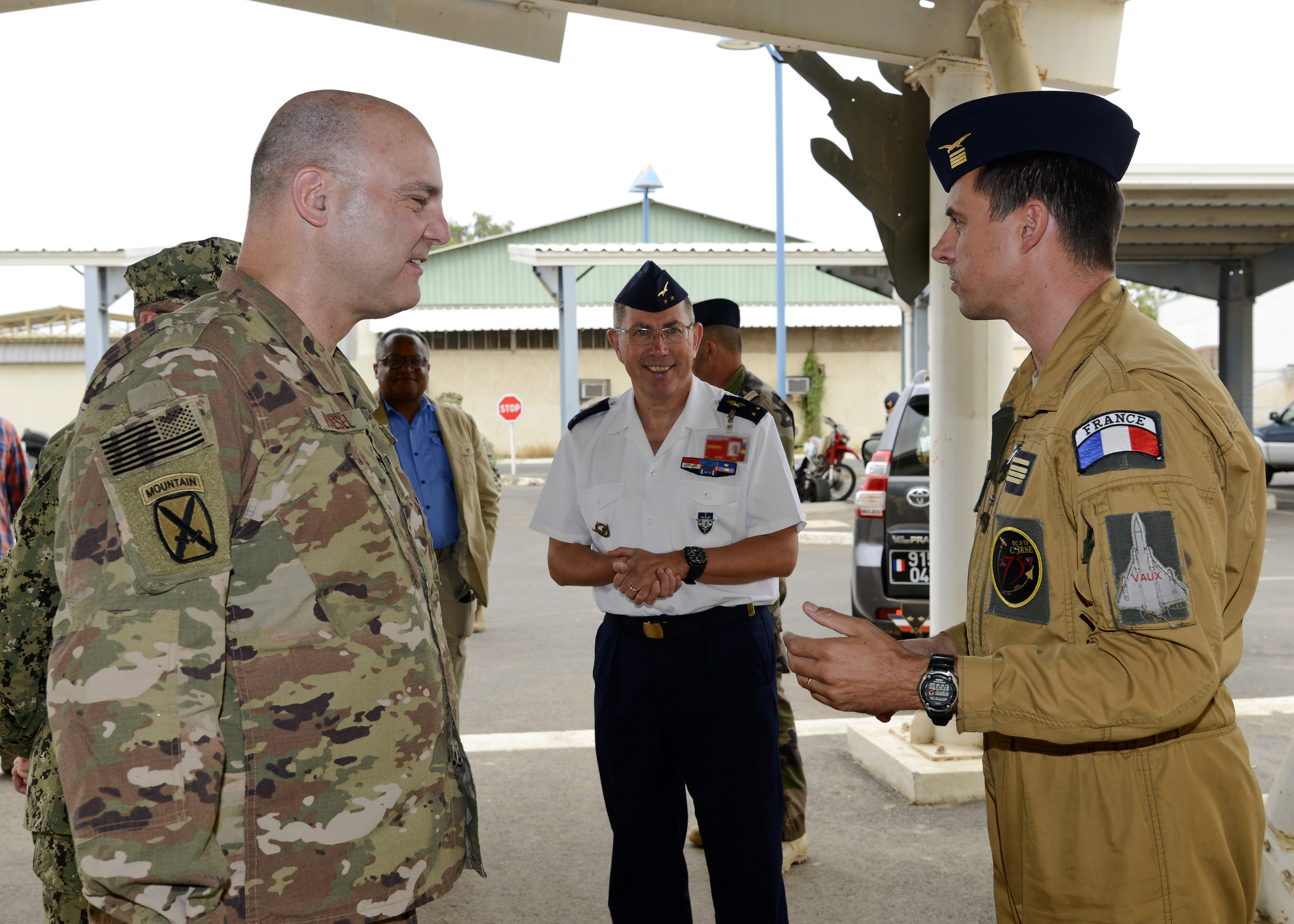 U.S. Air Force Brig. Gen. James R. Kriesel (left), deputy commanding general of Combined Joint Task Force-Horn of Africa (CJTF-HOA), speaks with French air force Maj. Baptiste, a fighter squadron executive officer, during his visit to French Air Force Base 188, Djibouti, Feb. 19, 2019. Kriesel visited the French base to gain insight into their assets and capabilities as a U.S. ally in CJTF-HOA's combined joint operations area. (Courtesy Photo)