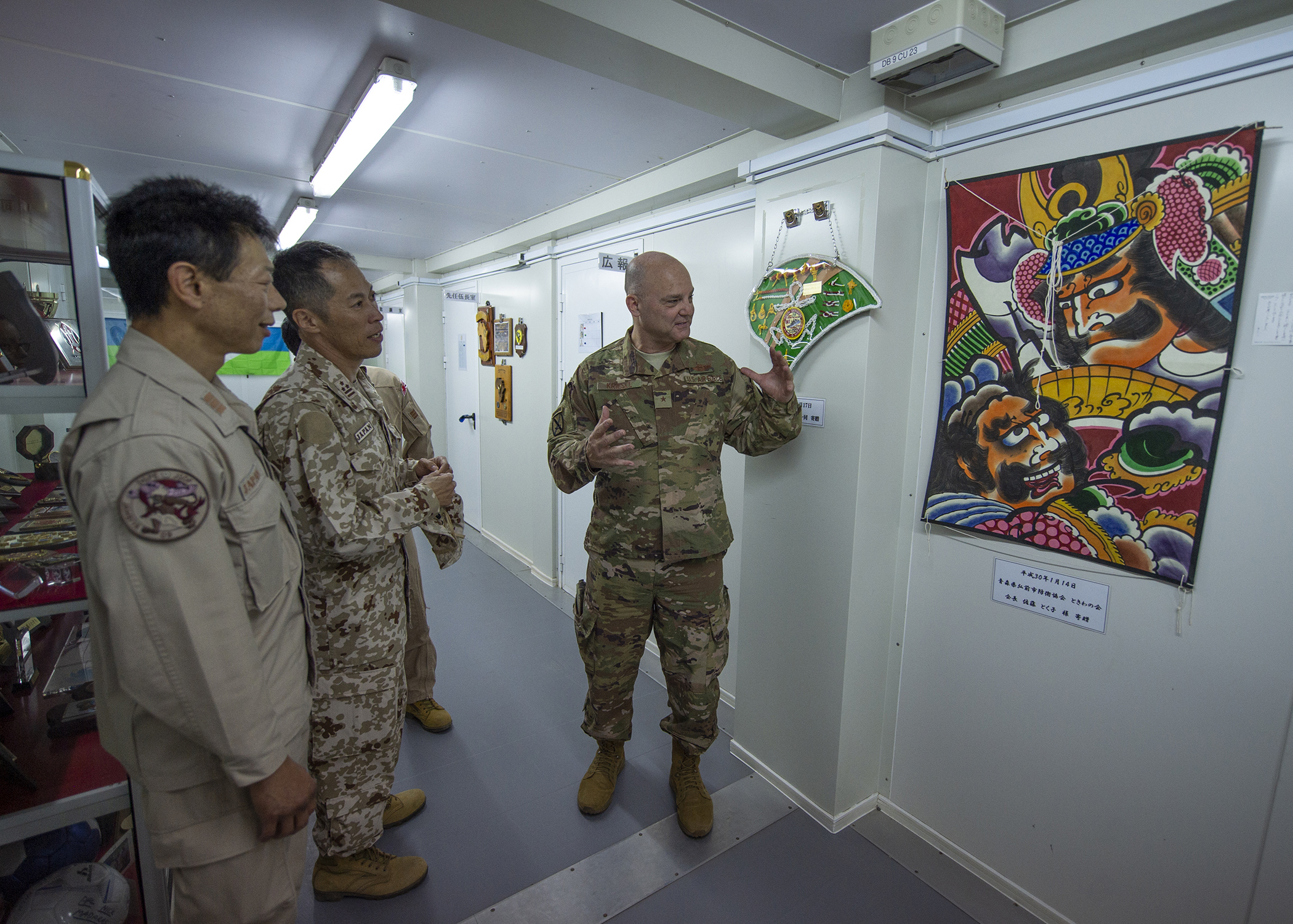 U.S. Air Force Brig. Gen. James R. Kriesel, deputy commanding general, Combined Joint Task Force-Horn of Africa (CJTF-HOA), compliments art hung in the Japanese Maritime Self Defense Force (JMSDF) headquarters while meeting with the coalition partners during a familiarization meet and greet March 4, 2019, in Djibouti. The meeting served as an opportunity for CJTF-HOA leadership to gain a better perspective of the JMSDF mission. (U.S. Air Force photo by Tech. Sgt. Shawn Nickel)