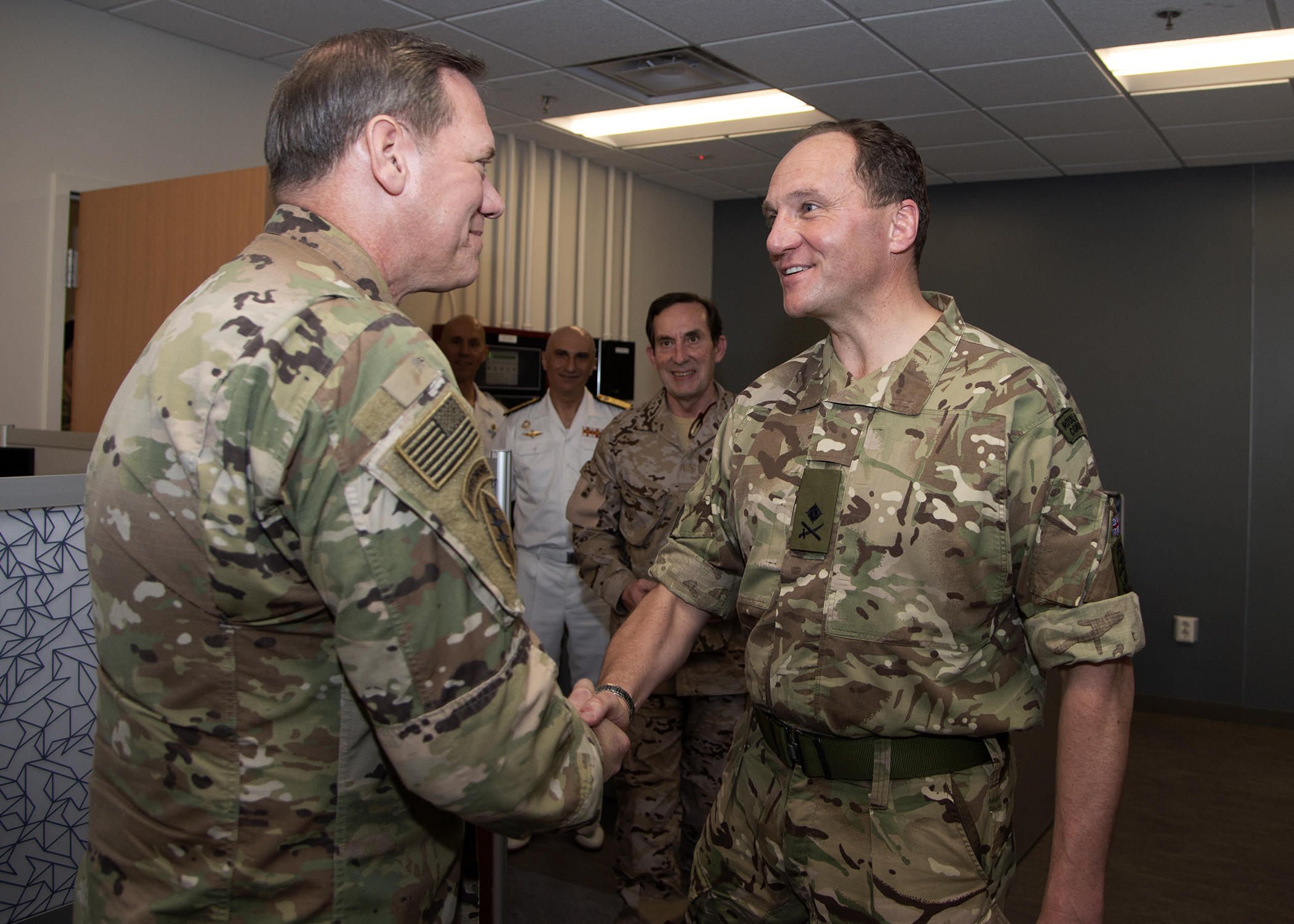 U.S. Army Maj. Gen. James D. Craig, left, commanding general, Combined Joint Task Force-Horn of Africa (CJTF-HOA), shakes hands with Royal Marines Maj. Gen. Charlie Strickland, outgoing operation commander, European Union Naval Force ATALANTA, at Camp Lemonnier, Djibouti, March 8, 2019. Strickland visited CJTF-HOA during a theater turnover with European Union partners. (U.S. Navy photo by Mass Communication Specialist 1st Class Nick Scott)