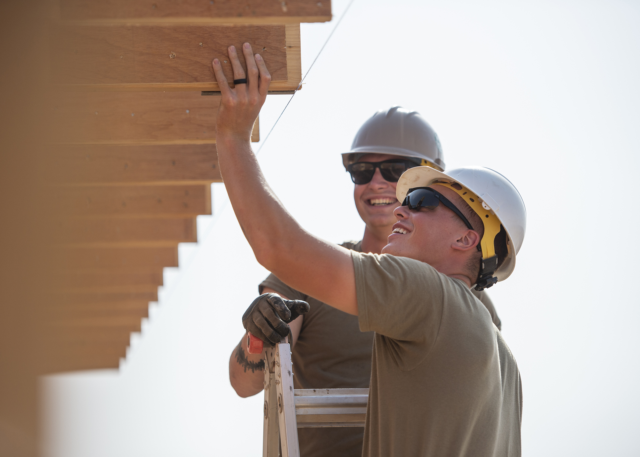 U.S. Army Soldiers from First Platoon, 465th Engineer Company, 926th Engineer Battalion, 926th Engineer Brigade, 412th Theater Engineer Command, based in Birmingham, Alabama, assigned to Combined Joint Task Force-Horn of Africa, cuts trusses to even lengths while building lodging at a forward operating location in East Africa, March 8, 2019. The lodging will replace temporary tents and accommodate U.S. Air Force and U.S. Army personnel at the location. (U.S. Air Force photo by Tech. Sgt. Shawn Nickel)