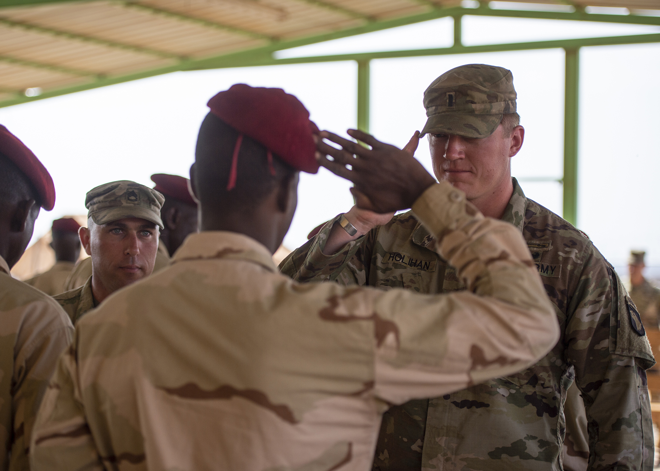 U.S. Army 1st Lt. Travis Holihan, the officer in charge of NCO training, Headquarters Company, 1-26 Infantry Battalion, 2nd Brigade Combat Team, 101st Airborne, assigned to Combined Joint Task Force-Horn of Africa, returns a salute during an NCO course graduation for the Rapid Intervention Battalion (RIB), a Djiboutian army elite military force, at a training location near Djibouti, March 7, 2019. U.S. Soldiers with Holihan's unit taught the course to the RIB soldiers. (U.S. Air Force photo by Tech. Sgt. Shawn Nickel)