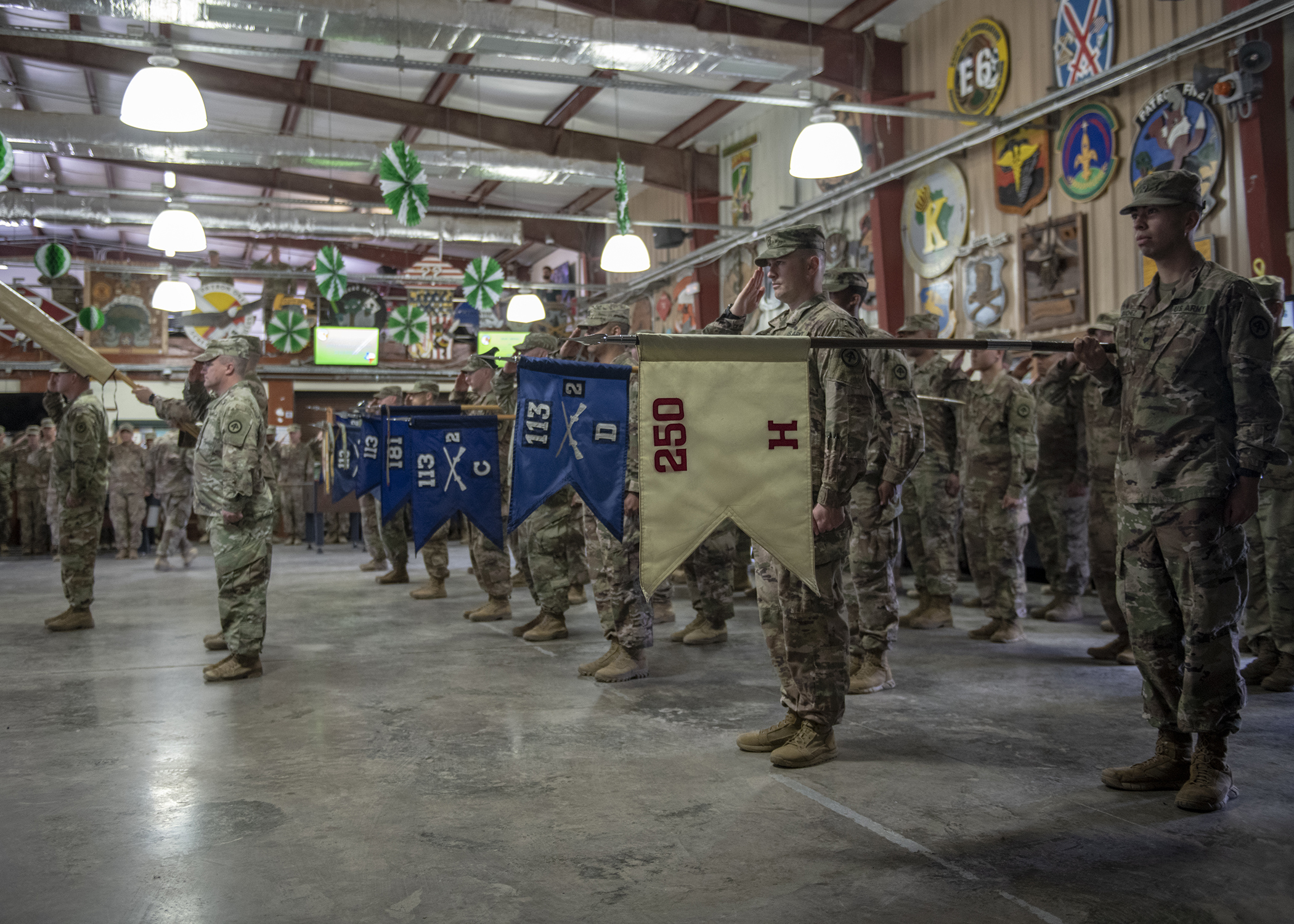 U.S. Army Soldiers from 2nd Battalion, 113th Infantry Regiment, Task Force Warrior, New Jersey National Guard, stand at attention during a transfer of authority ceremony at Camp Lemonnier, Djibouti, March 15, 2019. Task Force Warrior assumed responsibility as the security forces battalion for Combined Joint Task Force-Horn of Africa and will also contribute to international efforts to enhance security and stability in East Africa. (U.S. Air Force Photo by Tech. Sgt. Shawn Nickel)