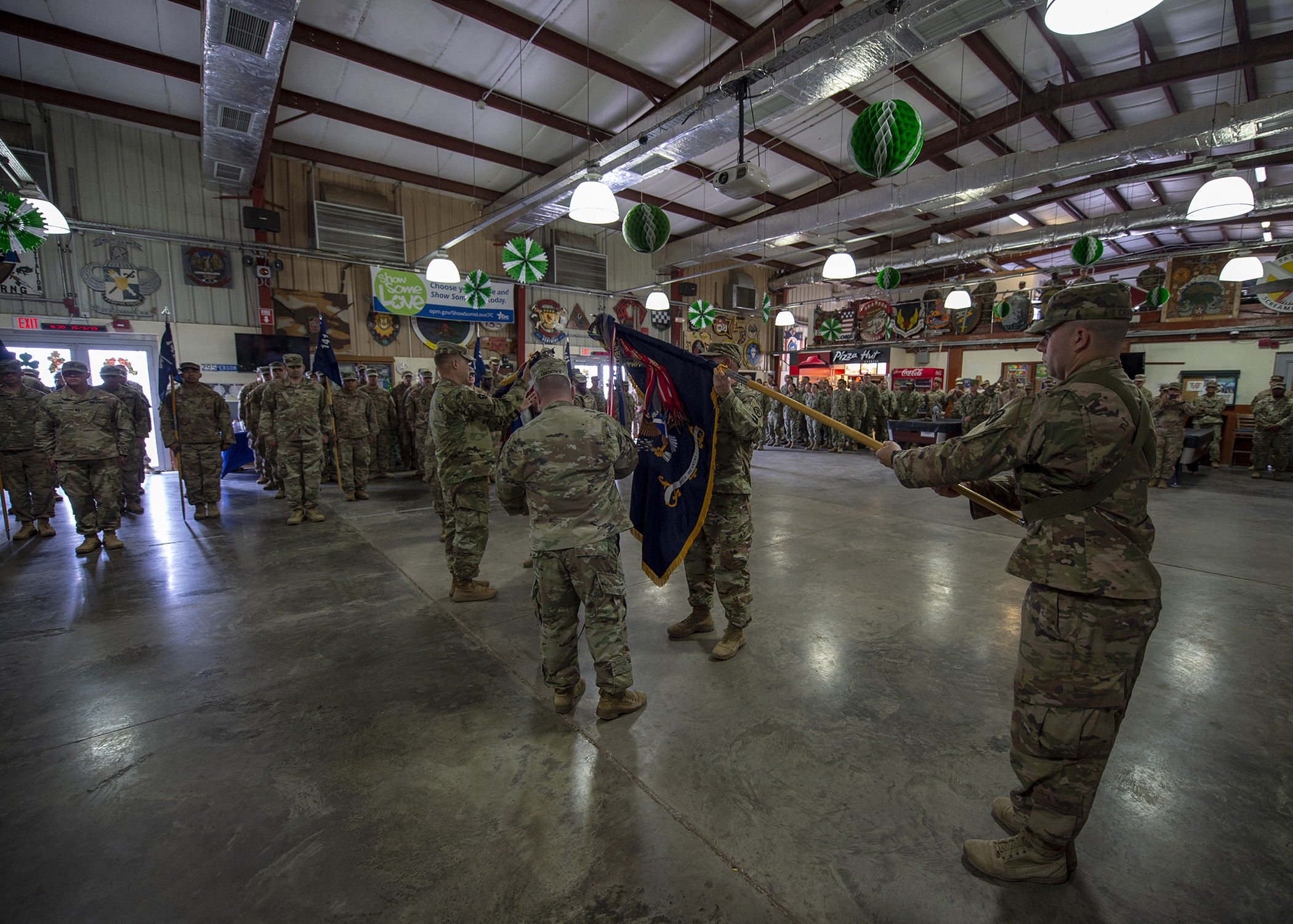 U.S. Army Soldiers from 2nd Battalion, 113th Infantry Regiment, Task Force Warrior, New Jersey National Guard, assume responsibility of their mission at Combined Joint Task Force-Horn of Africa (CJTF-HOA) from 1st Battalion, 141st Infantry Regiment, Task Force Alamo, Texas National Guard during a transfer of authority ceremony at Camp Lemonnier, Djibouti, March 15, 2019. Task Force Warrior assumed responsibility as the security forces battalion for CJTF-HOA and will also contribute to international efforts to enhance security and stability in East Africa. (U.S. Air Force Photo by Tech. Sgt. Shawn Nickel)