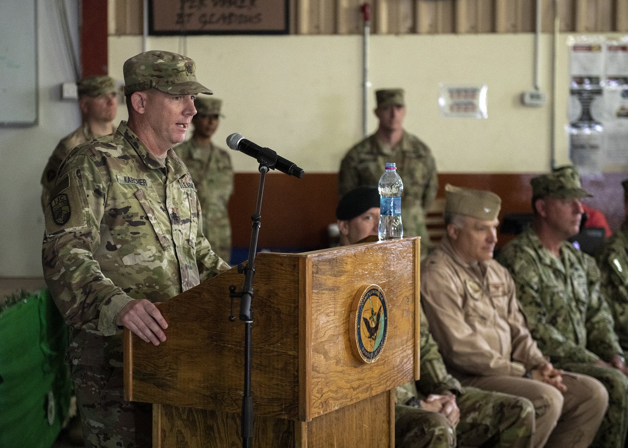 U.S. Army Lt. Col. Richard Karcher, commander, 2nd Battalion, 113th Infantry Regiment, Task Force Warrior, New Jersey National Guard, gives a speech while assuming his unit's mission at Combined Joint Task Force-Horn of Africa (CJTF-HOA) to 2nd Battalion, 113th Infantry Regiment, Task Force Warrior, New Jersey National Guard, during a transfer of authority ceremony at Camp Lemonnier, Djibouti, March 15, 2019. Task Force Warrior assumed responsibility as the security forces battalion for CJTF-HOA and will also contribute to international efforts to enhance security and stability in East Africa. (U.S. Air Force Photo by Tech. Sgt. Shawn Nickel)