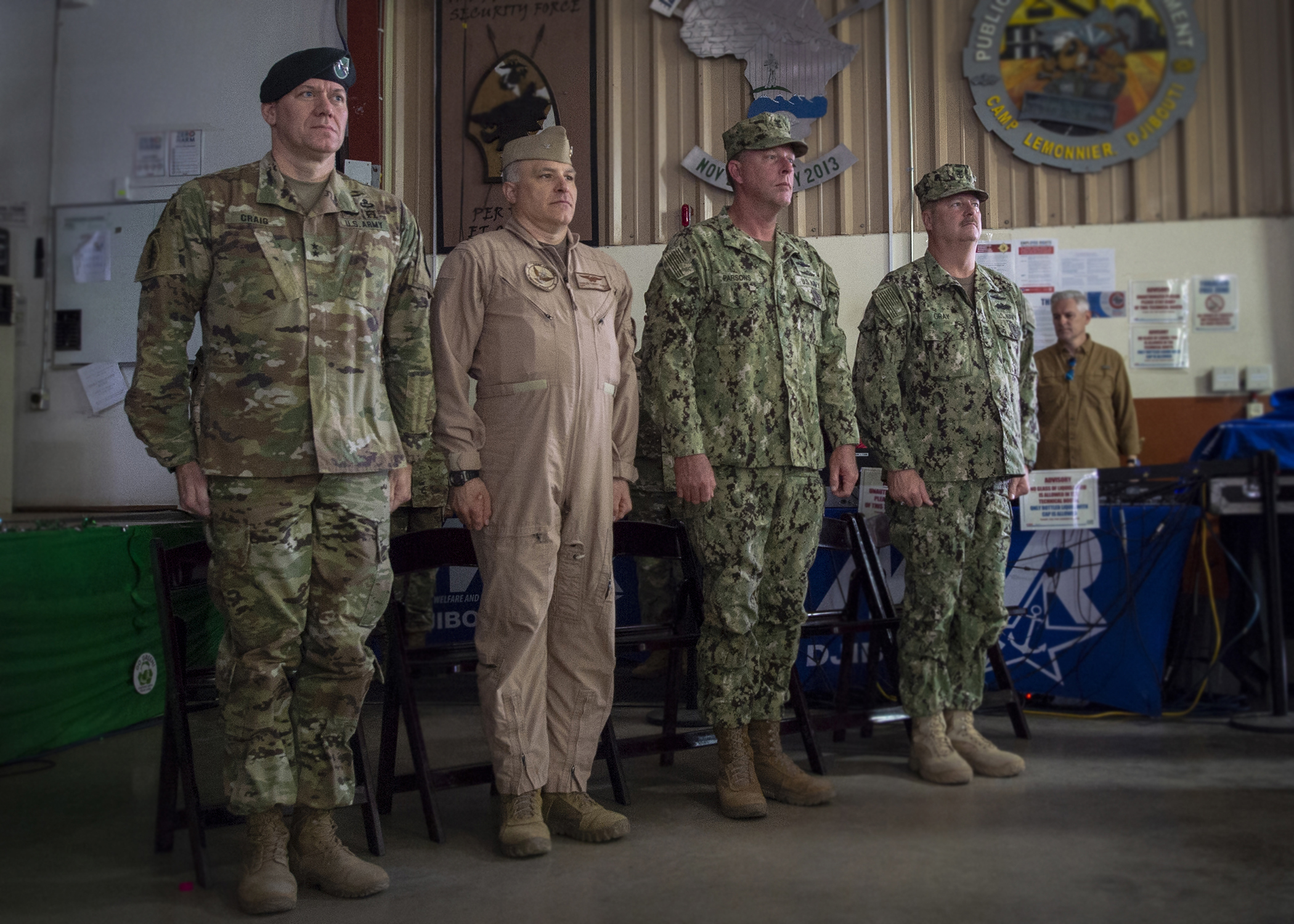 Left to right, U.S. Army Maj. Gen. James D. Craig, commanding general, Combined Joint Task Force-Horn of Africa (CJTF-HOA); U.S. Navy Capt. Charles J. DeGilio, commanding officer, Camp Lemonnier, Djibouti; U.S. Navy Master Chief Petty Officer Karl W. Parsons, command senior enlisted leader, CJTF-HOA; and U.S. Navy Master Chief Petty Officer Andy L. Gray, command senior enlisted leader, Camp Lemonnier, stand at attention during a transfer of authority ceremony at Camp Lemonnier, March 15, 2019. U.S. Army Soldiers from 2nd Battalion, 113th Infantry Regiment, Task Force Warrior, New Jersey National Guard, assumed authority of their mission at CJTF-HOA from 1st Battalion, 141st Infantry, Task Force Alamo, Texas National Guard during the ceremony. (U.S. Air Force Photo by Tech. Sgt. Shawn Nickel)