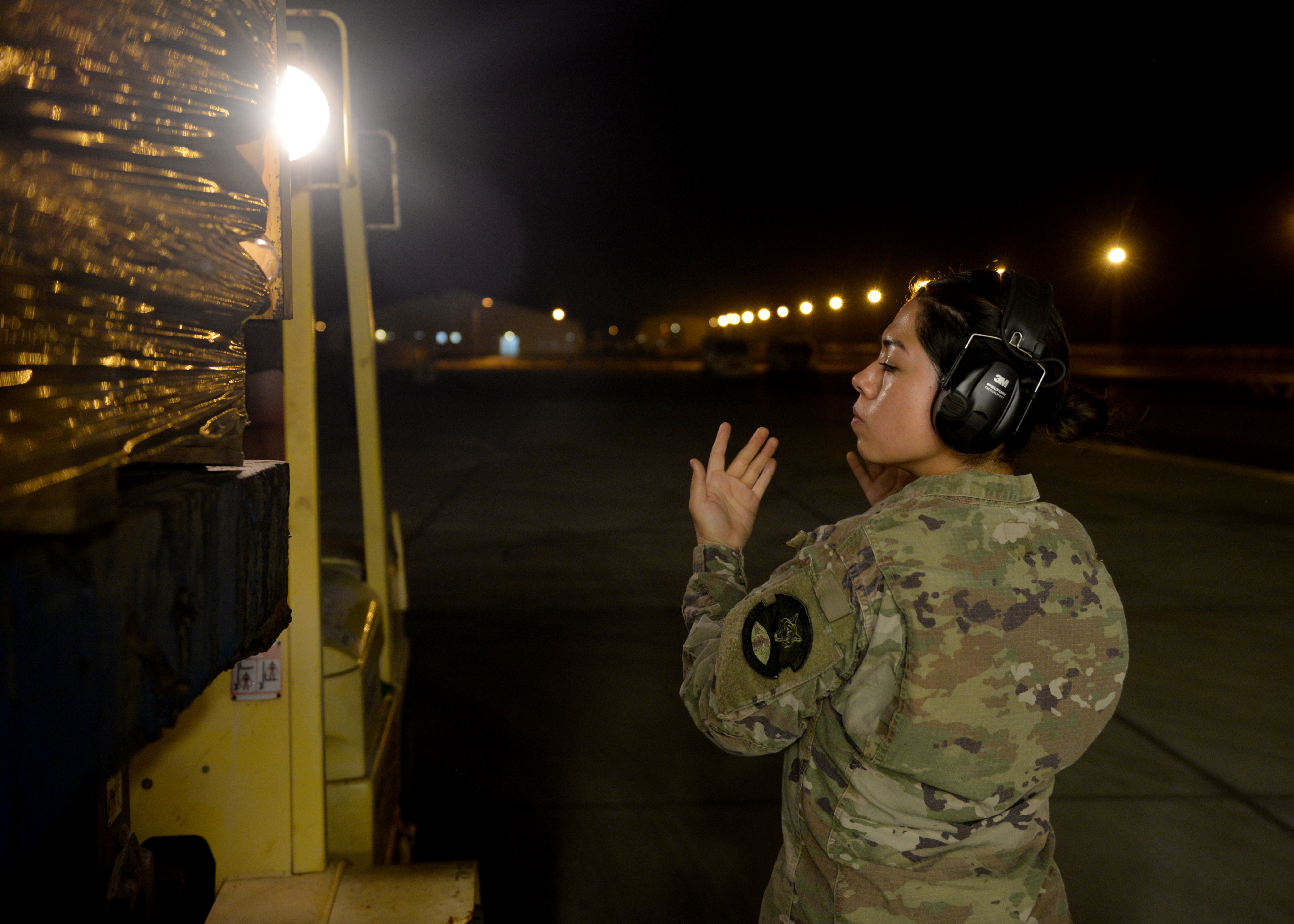 U.S. Air Force Senior Airman Lucy DeJesus, mobile aerial porter for the 435th Contingency Response Group, Ramstein Air Base, Germany, currently at Camp Lemonnier, Djibouti, supporting Combined Joint Task Force-Horn of Africa (CJTF-HOA), guides a forklift operator unloading supplies from the U.S. Agency for International Development (USAID) at Camp Lemonnier, March 31, 2019, for the U.S. Department of Defense's (DoD) humanitarian relief effort in the Republic of Mozambique and surrounding areas following Cyclone Idai. Teams supporting CJTF-HOA, which is leading the DoD relief effort, prepared cargo for transport following a call for assistance from the USAID Disaster Assistance Response Team. (U.S. Air Force photo by Staff Sgt. Franklin R. Ramos)