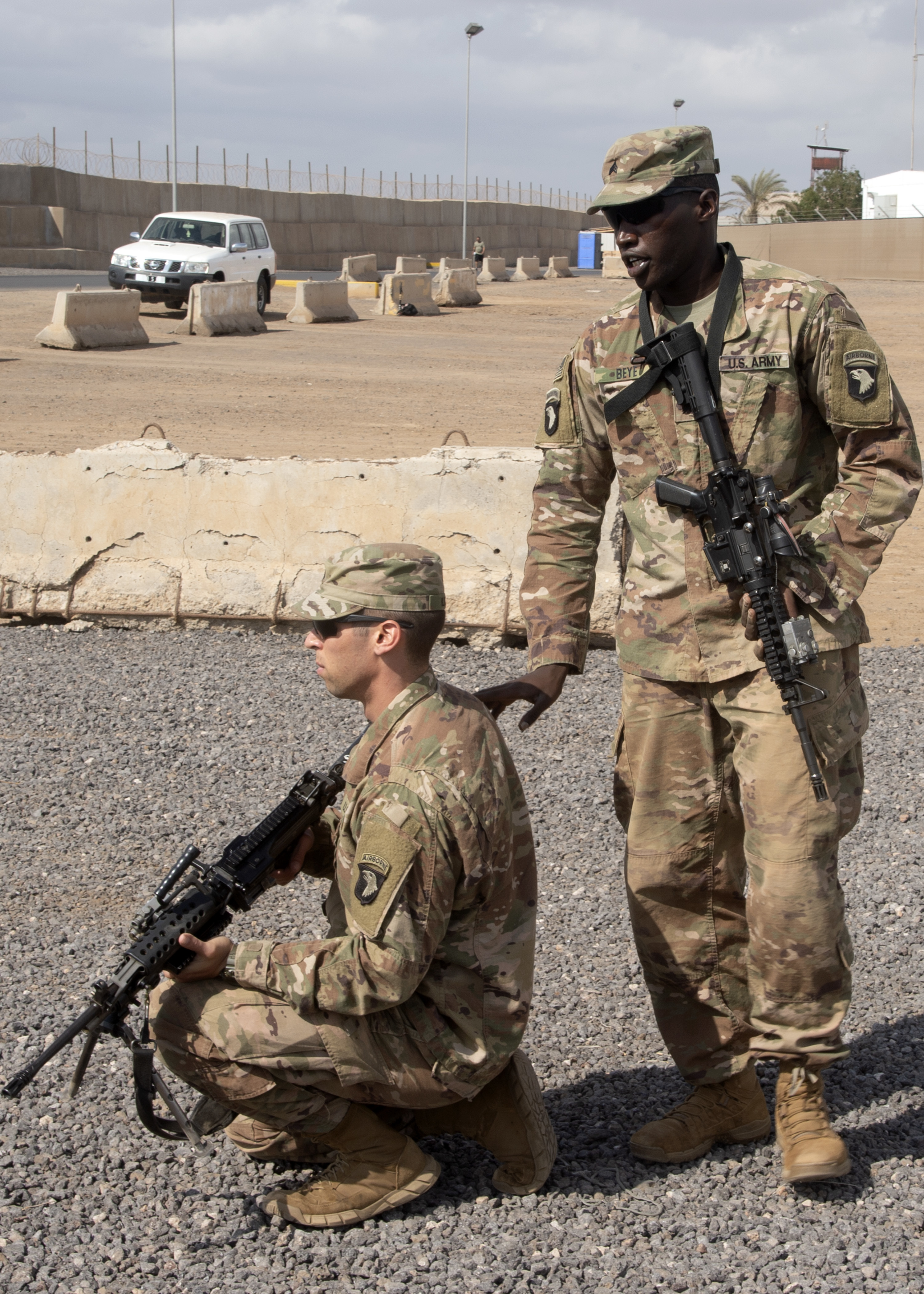 U.S. Army Sgt. Elhadji Beye, Viper Company, 1-26 Infantry, 101st Airborne Division (Air Assault), with the East Africa Response Force (EARF) assigned to Combined Joint Task Force-Horn of Africa, instructs U.S. Army Spc. George Iliou at Camp Lemonnier, Djibouti, Feb. 8, 2019. The purpose of the EARF is to rapidly provide tailorable packages of forces to protect American interests on the African continent should any threats arise. (U.S. Navy Photo by Mass Communication Specialist 1st Class Nick Scott)