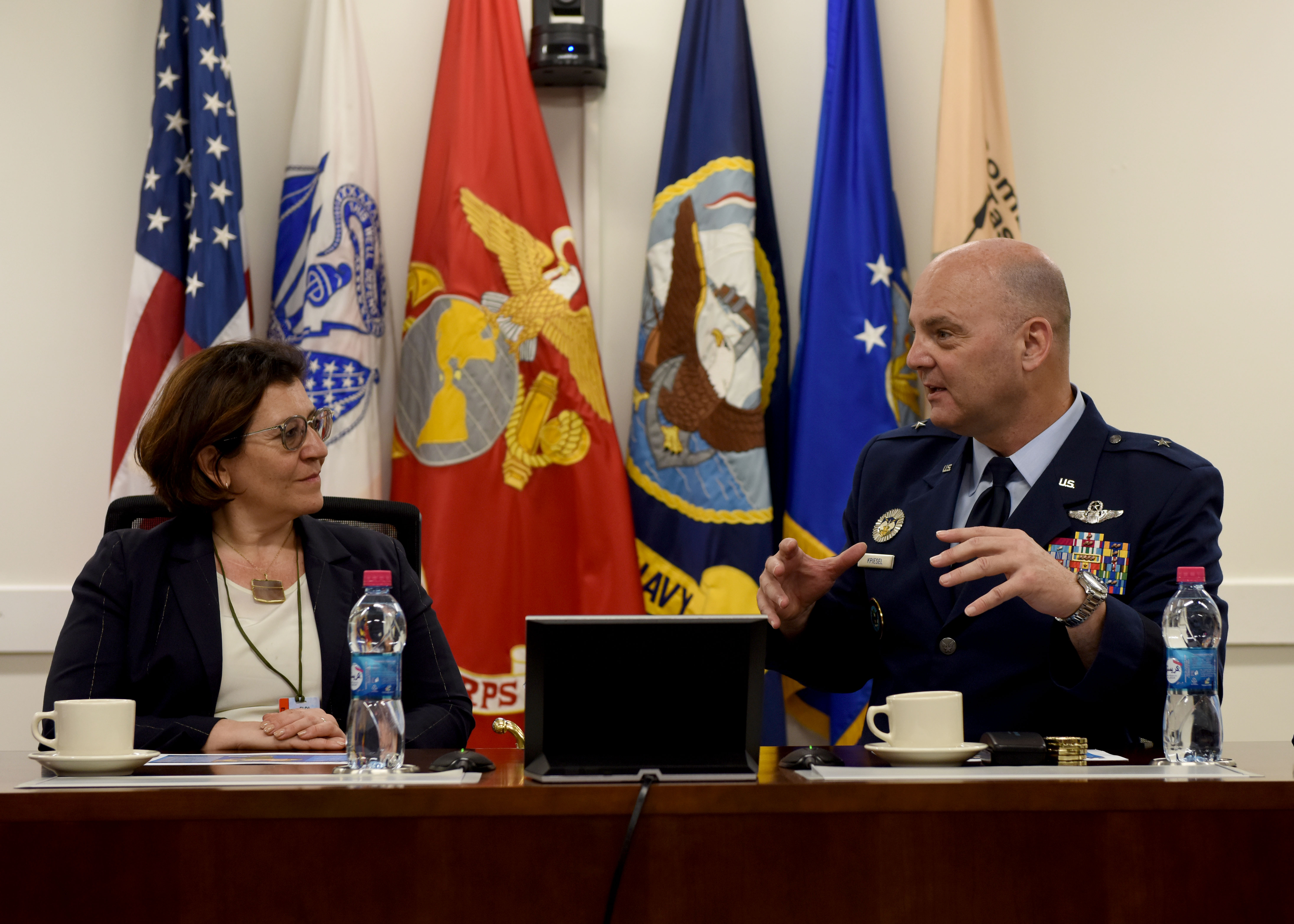 Elisabetta Trenta, Italian Minister of Defense, left, listens to U.S. Air Force Brig. Gen. James R. Kriesel, deputy commanding general of Combined Joint Task Force-Horn of Africa (CJTF- HOA), to gain insight into the partnership between the two nations on the African continent during her visit to Camp Lemonnier, Djibouti, April 9, 2019. Trenta visited CJTF-HOA to gain insight on how U.S. forces operate in the combined joint operations area and to foster relations. (U.S. Air Force Photo by Staff Sgt. Franklin R. Ramos)