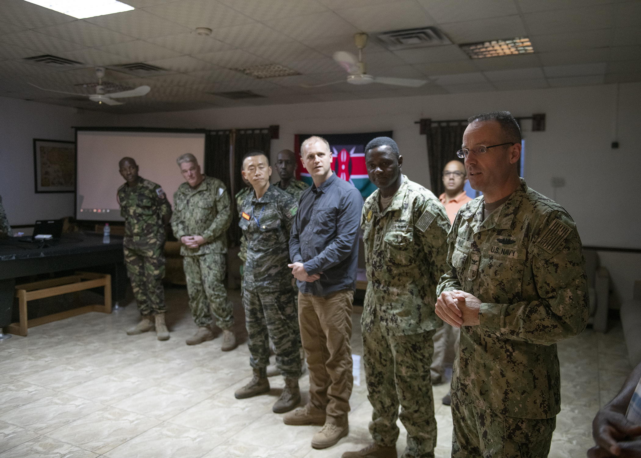U.S. Navy Capt. Thomas Wall, chief of staff for Combined Joint Task Force-Horn of Africa (CJTF-HOA), greets multinational military partners during a cultural exchange event at Camp Lemonnier, Djibouti, March 27, 2019. CJTF-HOA holds monthly exchange events with multinational military partners affiliated with Camp Lemonnier to strengthen alliances and attract new partners in the combined joint military environment. (U.S. Air Force photo by Tech. Sgt. Shawn Nickel)