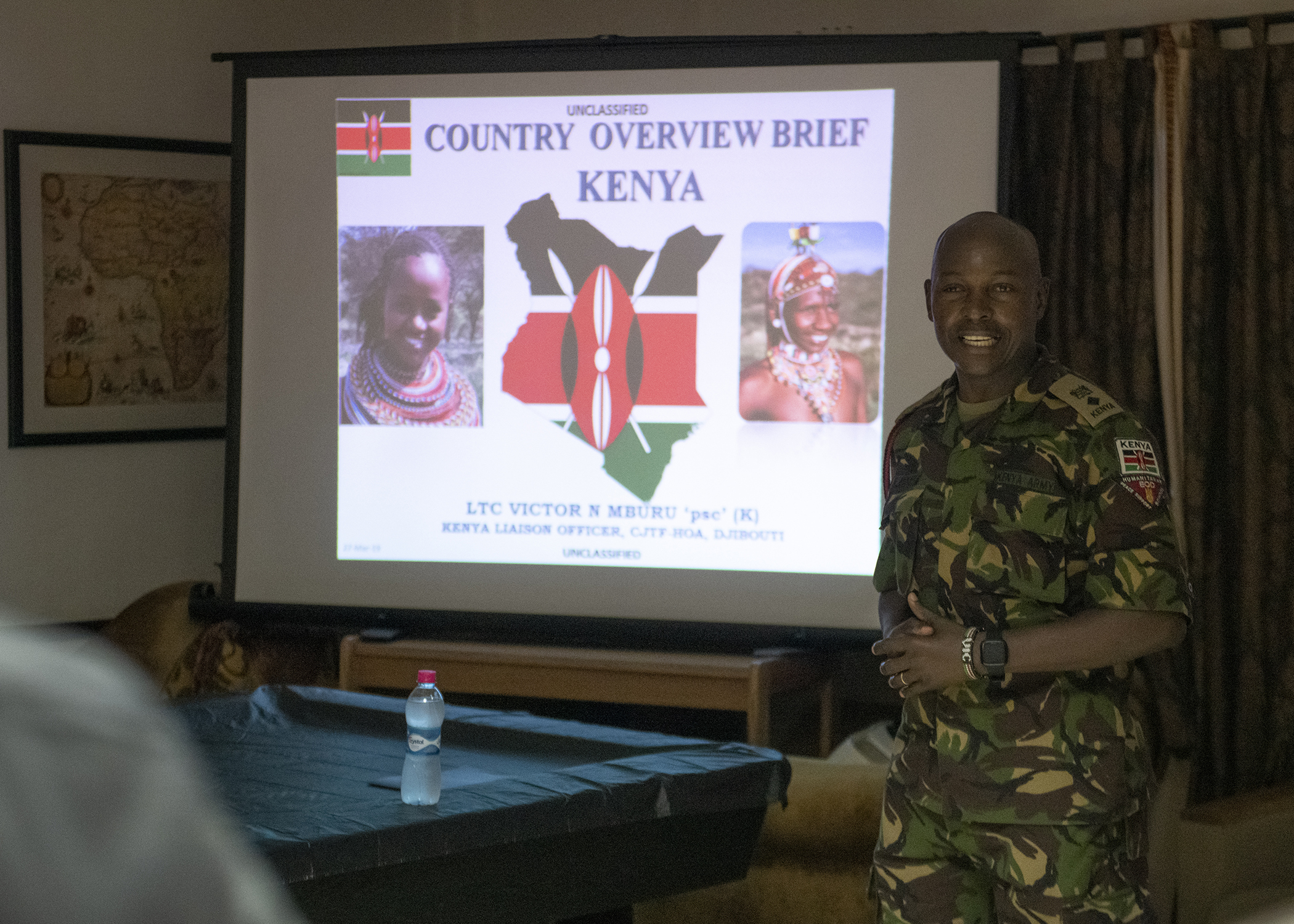 Kenya Defence Force Lt. Col. Victor Mburu, a foreign liaison officer assigned to Combined Joint Task Force-Horn of Africa (CJTF-HOA), presents information on his home country to multinational military partners during a cultural exchange event at Camp Lemonnier, Djibouti, March 27, 2019. CJTF-HOA holds monthly exchange events with multinational military partners affiliated with Camp Lemonnier to strengthen alliances and attract new partners in the combined joint military environment. (U.S. Air Force photo by Tech. Sgt. Shawn Nickel)