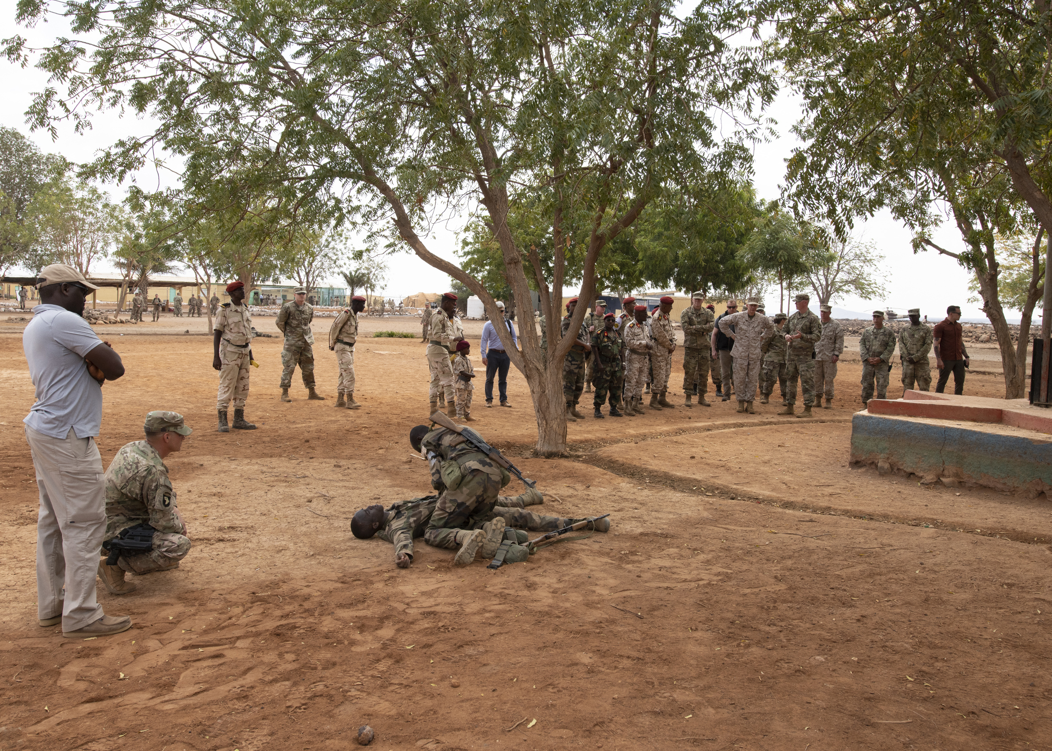 U.S. Marine Corps Gen. Thomas D. Waldhauser, commander of U.S. Africa Command, watches a demonstration by soldiers assigned to the Rapid Intervention Battalion, the Djiboutian army's elite military force, during a visit with senior Djiboutian officials, including Chief of General Staff of the Djibouti Armed Forces Zakaria Cheik Ibrahim, at a training base in Djibouti, March 21, 2019. Waldhauser visited in order to discuss the growth and development of Djiboutian security forces. (U.S. Air Force photo by Tech. Sgt. Shawn Nickel)