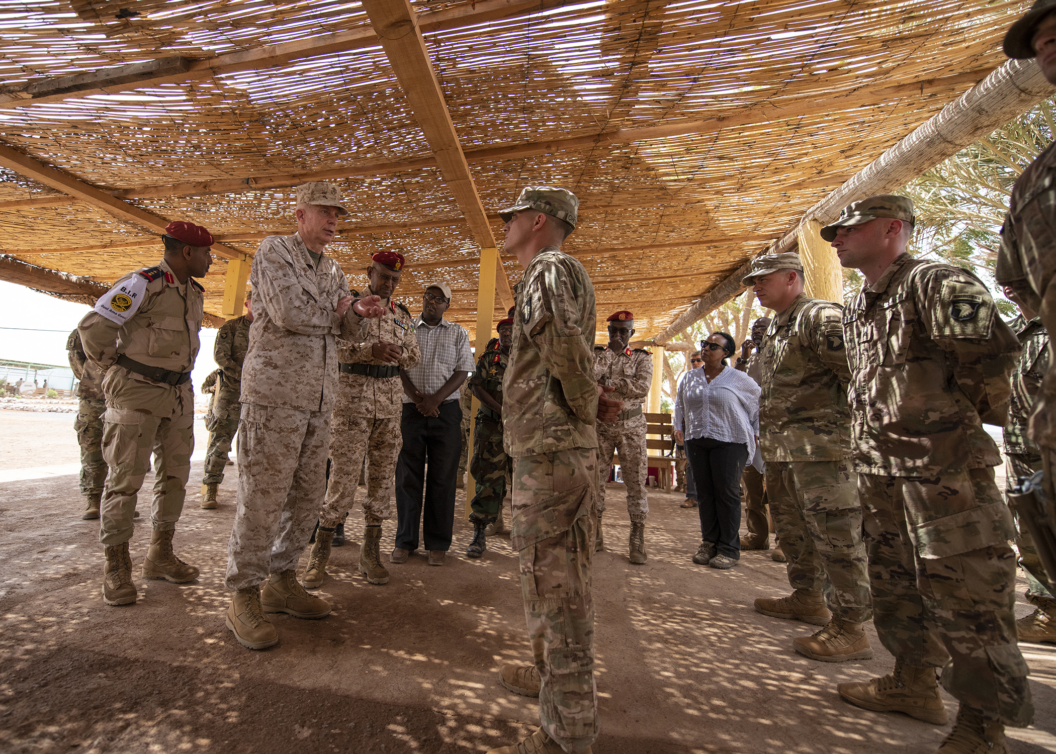 U.S. Marine Corps Gen. Thomas D. Waldhauser, left center, commander of U.S. Africa Command, addresses U.S. Army Soldiers fromHeadquarters Company, 1-26 Infantry Battalion, 2nd Brigade Combat Team, 101st Airborne, assigned to Combined Joint Task Force-Horn of Africa, who train Rapid Intervention Battalion (RIB) soldiers during his visit with senior Djiboutian officials, including Chief of General Staff of the Djibouti Armed Forces Zakaria Cheik Ibrahim, at a training base in Djibouti, March 21, 2019. While in Djibouti, Waldhauser observed the ongoing growth and development of the RIB, the Djiboutian army's elite military force, which the U.S. is in the process of training and equipping at the request of the Djiboutian government. (U.S. Air Force photo by Tech. Sgt. Shawn Nickel)