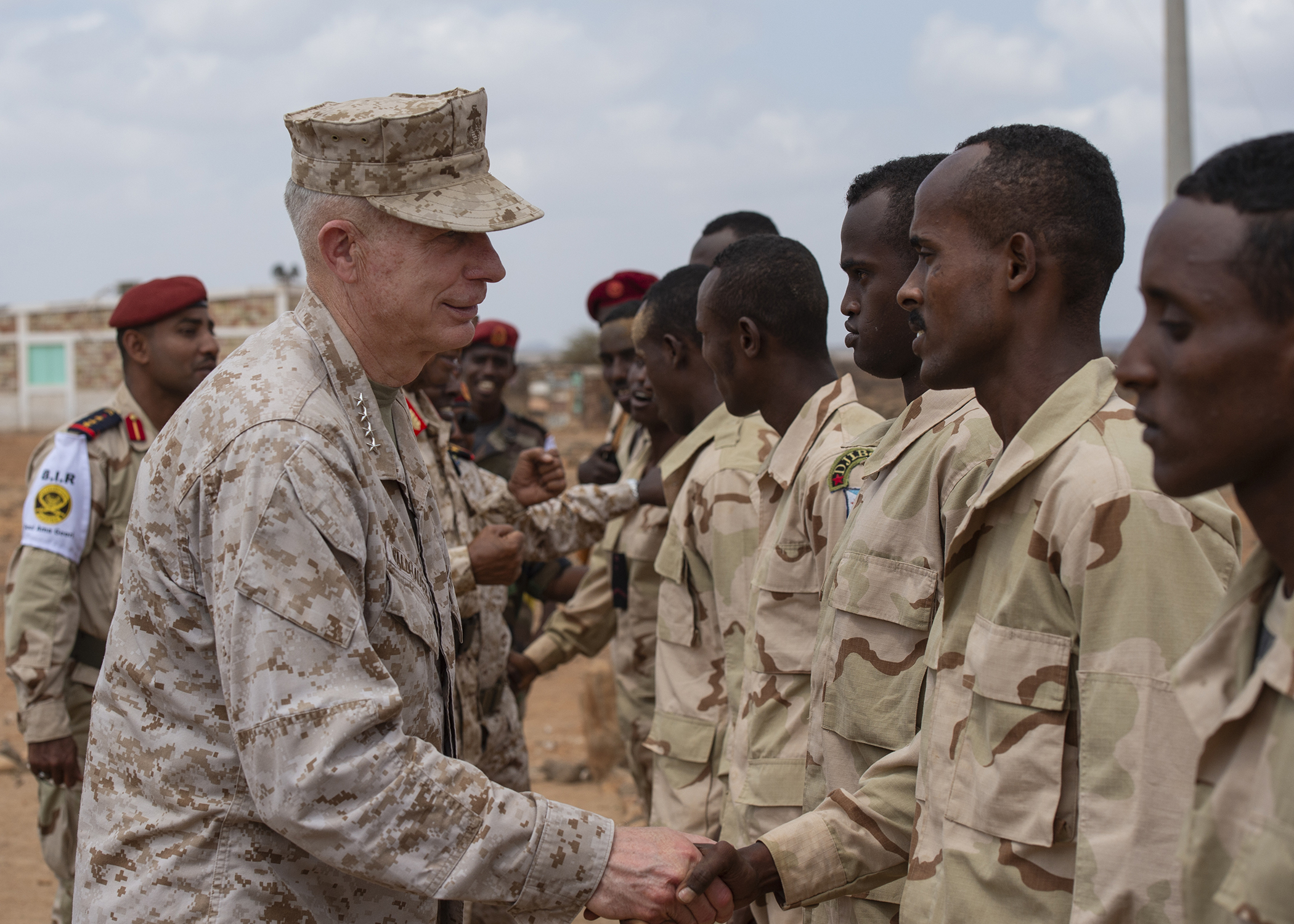 U.S. Marine Corps Gen. Thomas D. Waldhauser, commander of U.S. Africa Command, thanks soldiers from the Djiboutian army's elite military force, the Rapid Intervention Battalion, after demonstrating hand-to-hand combat during a visit with senior Djiboutian officials, including Chief of General Staff of the Djibouti Armed Forces Gen. Zakaria Cheik Ibrahim, at a training base in Djibouti, March 21, 2019. Waldhauser visited in order to discuss the growth and development of Djiboutian security forces. (U.S. Air Force photo by Tech. Sgt. Shawn Nickel)