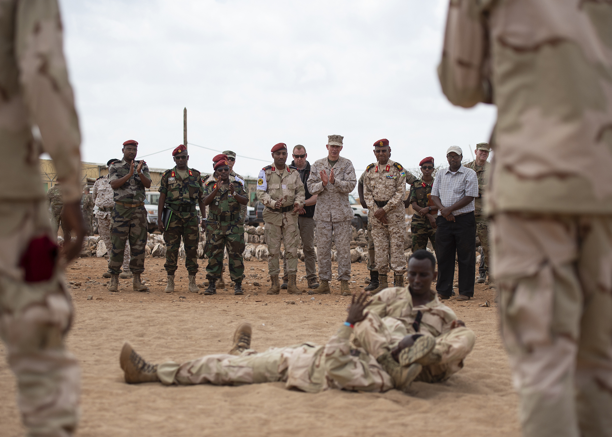 U.S. Marine Corps Gen. Thomas D. Waldhauser, commander of U.S. Africa Command, claps after a demonstration by soldiers from the Djiboutian army's elite military force, the Rapid Intervention Battalion, during a visit with senior Djiboutian officials, including Chief of General Staff of the Djibouti Armed Forces Zakaria Cheik Ibrahim, at a training base in Djibouti, March 21, 2019. Waldhauser visited in order to discuss the growth and development of Djiboutian security forces. (U.S. Air Force photo by Tech. Sgt. Shawn Nickel)