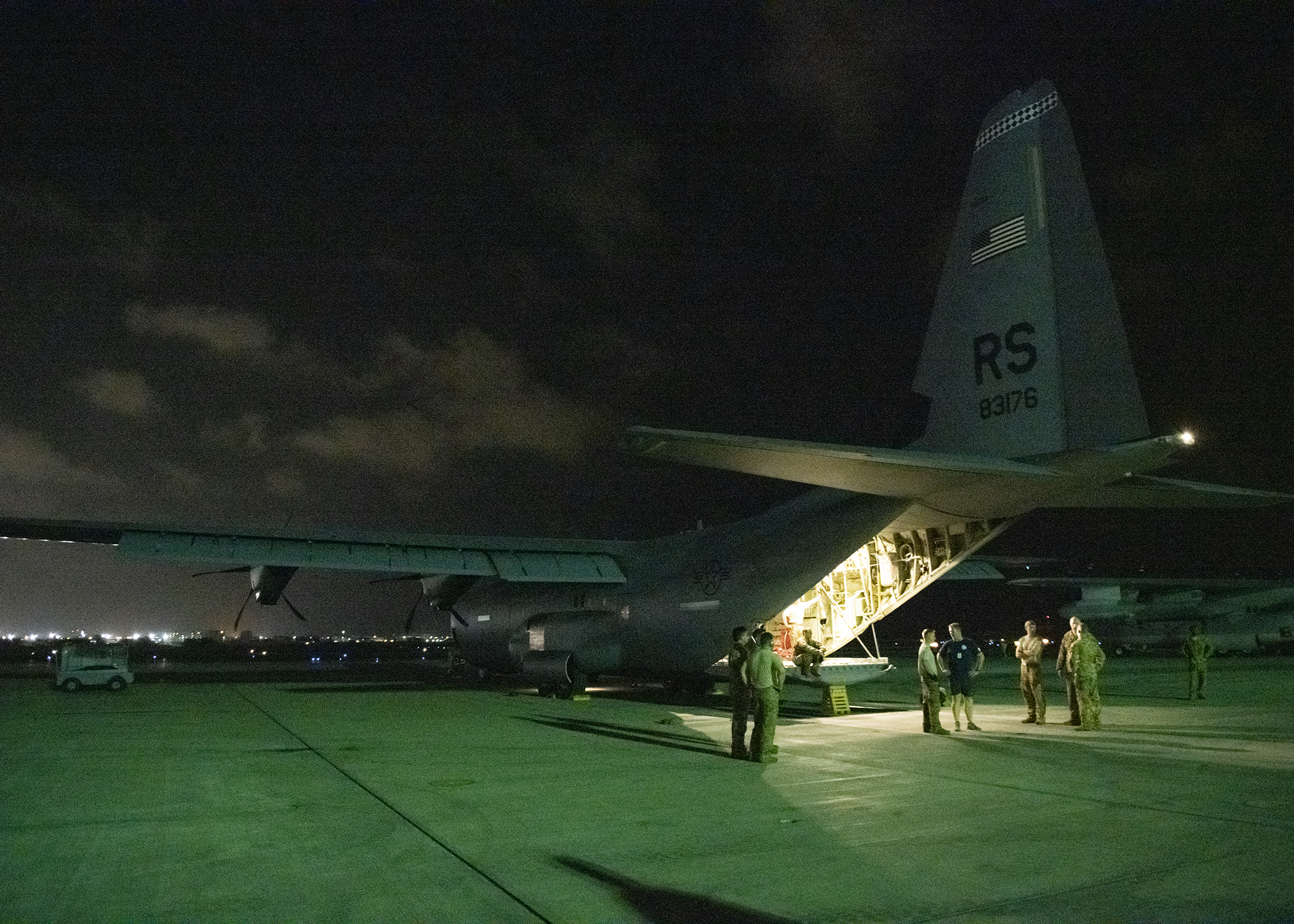 Service members assigned to Combined Joint Task Force-Horn of Africa (CJTF-HOA) and U.S. Air Force C-130J Super Hercules aircrew members assigned to Ramstein Air Base, Germany, return to Camp Lemonnier, Djibouti, April 12, 2019, after supporting Cyclone Idai humanitarian relief efforts in Mozambique. CJTF-HOA personnel transported more than 782 metric tons of U.S. Government-provided humanitarian relief supplies to Cyclone-impacted areas in Mozambique. (U.S. Air Force photo by Tech. Sgt. Shawn Nickel)