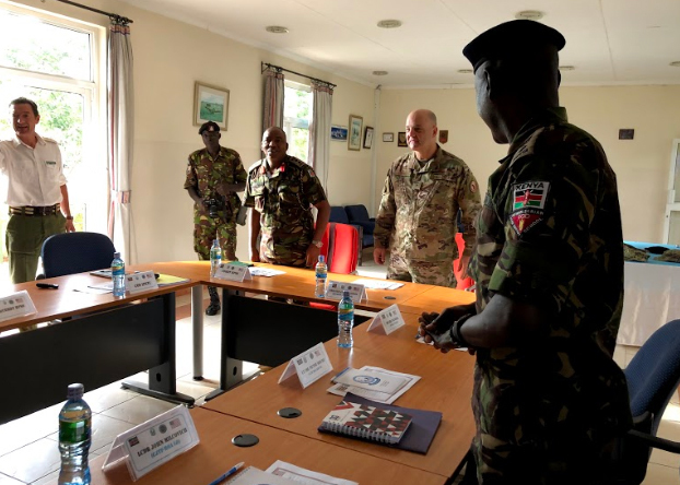 U.S. Air Force Brig. Gen. James R. Kriesel, deputy commanding general, Combined Joint Task Force-Horn of Africa (CJTF-HOA), greets the participants of the Counter-Improvised Explosive Device strategy development seminar, hosted by the Humanitarian and Peace Support School, in Nairobi's Embakasi district, April 2, 2019. Kriesel visited the Kenyan capital of Nairobi, April 2-3, 2019, as part of a familiarization tour of the CJTF-HOA combined joint operations area. (U.S. Air Force photo by Capt. Sharya Qureshi)