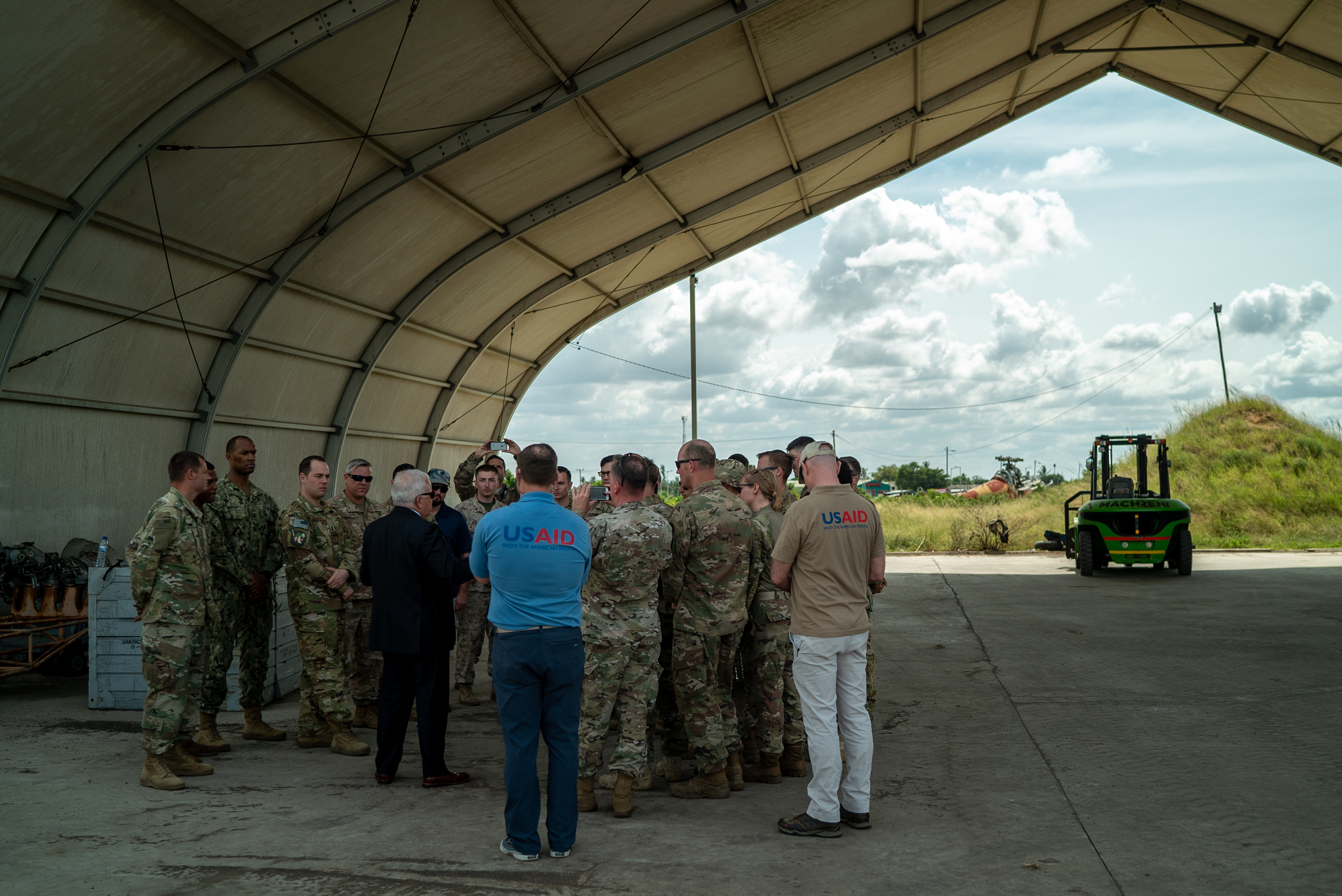 Dennis Walter Hearne, U.S. Ambassador to the Republic of Mozambique, meets with U.S. service members assigned to Combined Joint Task Force-Horn of Africa (CJTF-HOA) in Maputo, Mozambique, April 11, 2019. CJTF-HOA led U.S. Department of Defense Cyclone Idai relief efforts in support of U.S. Agency for International Development's (USAID) Disaster Assistance Response Team. The task force helped meet requirements identified by USAID assessment teams and humanitarian organizations working in the region by providing logistics support and manpower to USAID at the request of the Government of the Republic of Mozambique. (U.S. Air Force photo by Tech. Sgt. Thomas Grimes)