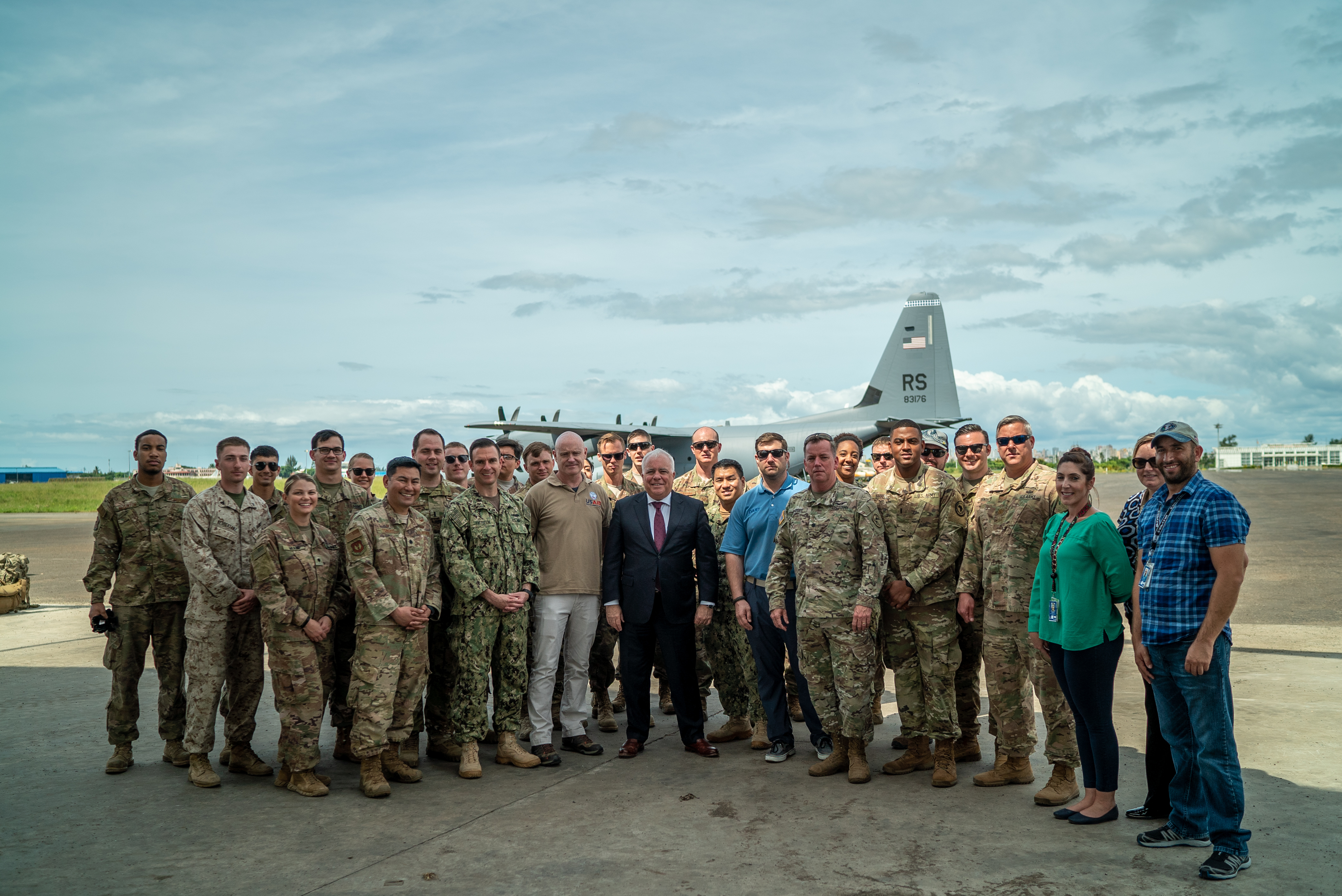 Dennis Walter Hearne, U.S. Ambassador to the Republic of Mozambique, poses for a photo with U.S. service members assigned to Combined Joint Task Force-Horn of Africa (CJTF-HOA) in Maputo, Mozambique, April 11, 2019. CJTF-HOA led U.S. Department of Defense Cyclone Idai relief efforts in support of U.S. Agency for International Development's (USAID) Disaster Assistance Response Team. The task force helped meet requirements identified by USAID assessment teams and humanitarian organizations working in the region by providing logistics support and manpower to USAID at the request of the Government of   the Republic of Mozambique. (U.S. Air Force photo by Tech. Sgt. Thomas Grimes)