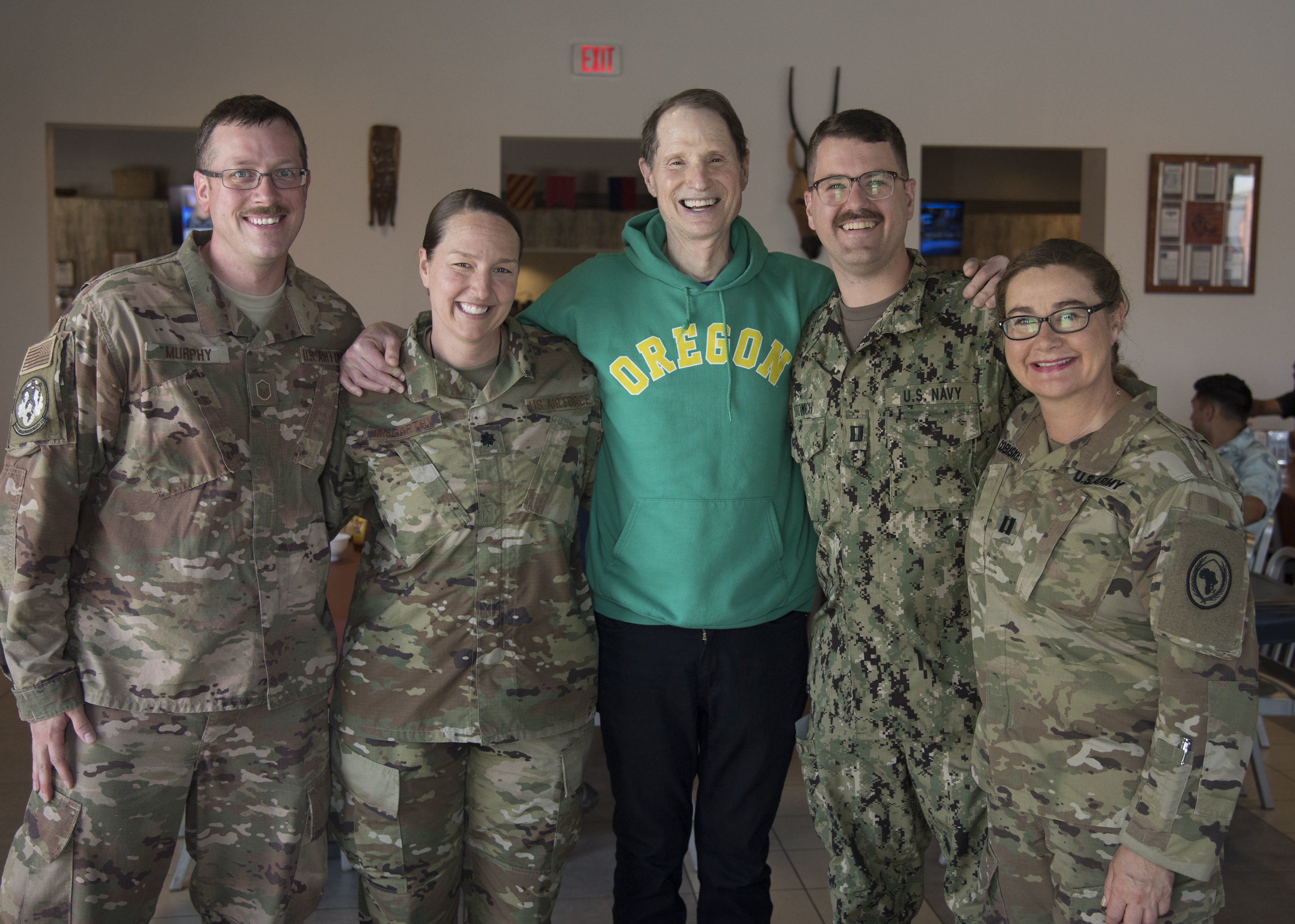 U.S. Sen. Ron Wyden (D-OR) poses for a photo with service members from Oregon deployed to Combined Joint Task Force-Horn of Africa (CJTF-HOA), Djibouti, April 26, 2019. Wyden traveled to Djibouti to visit U.S. forces and embassy officials and to meet with national defense leaders to understand the current posture of readiness and security. (U.S. Air Force photo by Senior Airman Kirsten Brandes)