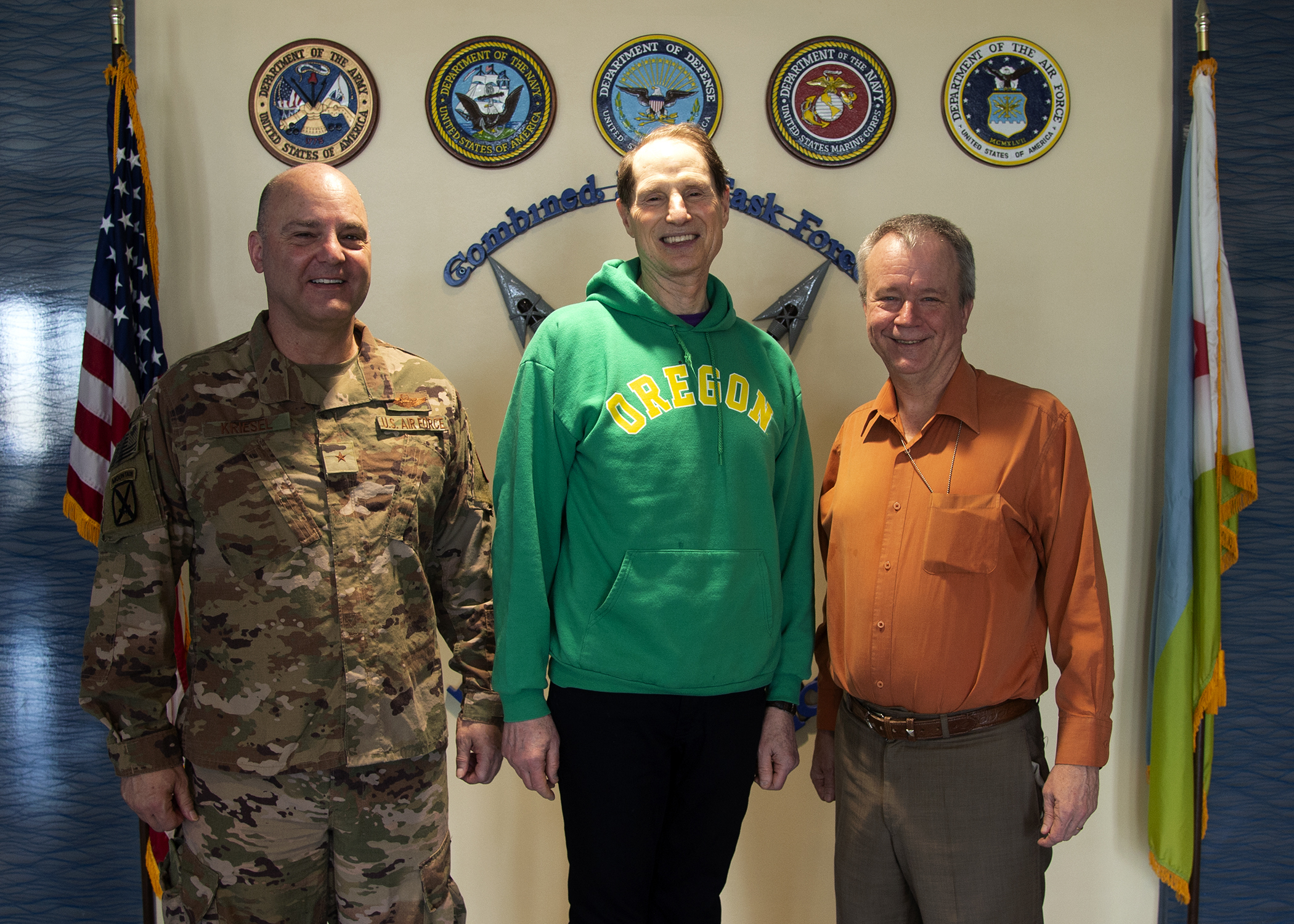 U.S. Air Force Brig. Gen. James R. Kriesel, left, deputy commanding general of Combined Joint Task Force-Horn of Africa (CJTF-HOA), U.S. Sen. Ron Wyden (D-OR), center, and U.S. Ambassador to Djibouti Larry André, right, pose for a photo at CJTF-HOA before a briefing at Camp Lemonnier, Djibouti, April 26, 2019. Wyden traveled to Djibouti to visit U.S. forces and embassy officials and to meet with national defense leaders to understand the current posture of readiness and security. (U.S. Navy photo by Mass Communication Specialist 1st Class Nick Scott)