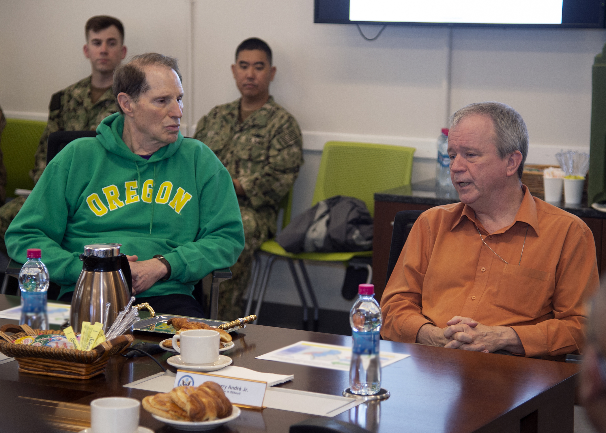U.S. Sen. Ron Wyden, left, (D-OR) speaks with U.S. Ambassador to Djibouti Larry André, right, during a briefing at Combined Joint Task Force-Horn of Africa, Camp Lemonnier, Djibouti, April 26, 2019. Wyden traveled to Djibouti to visit U.S. forces and embassy officials and to meet with national defense leaders to understand the current posture of readiness and security. (U.S. Navy photo by Mass Communication Specialist 1st Class Nick Scott)