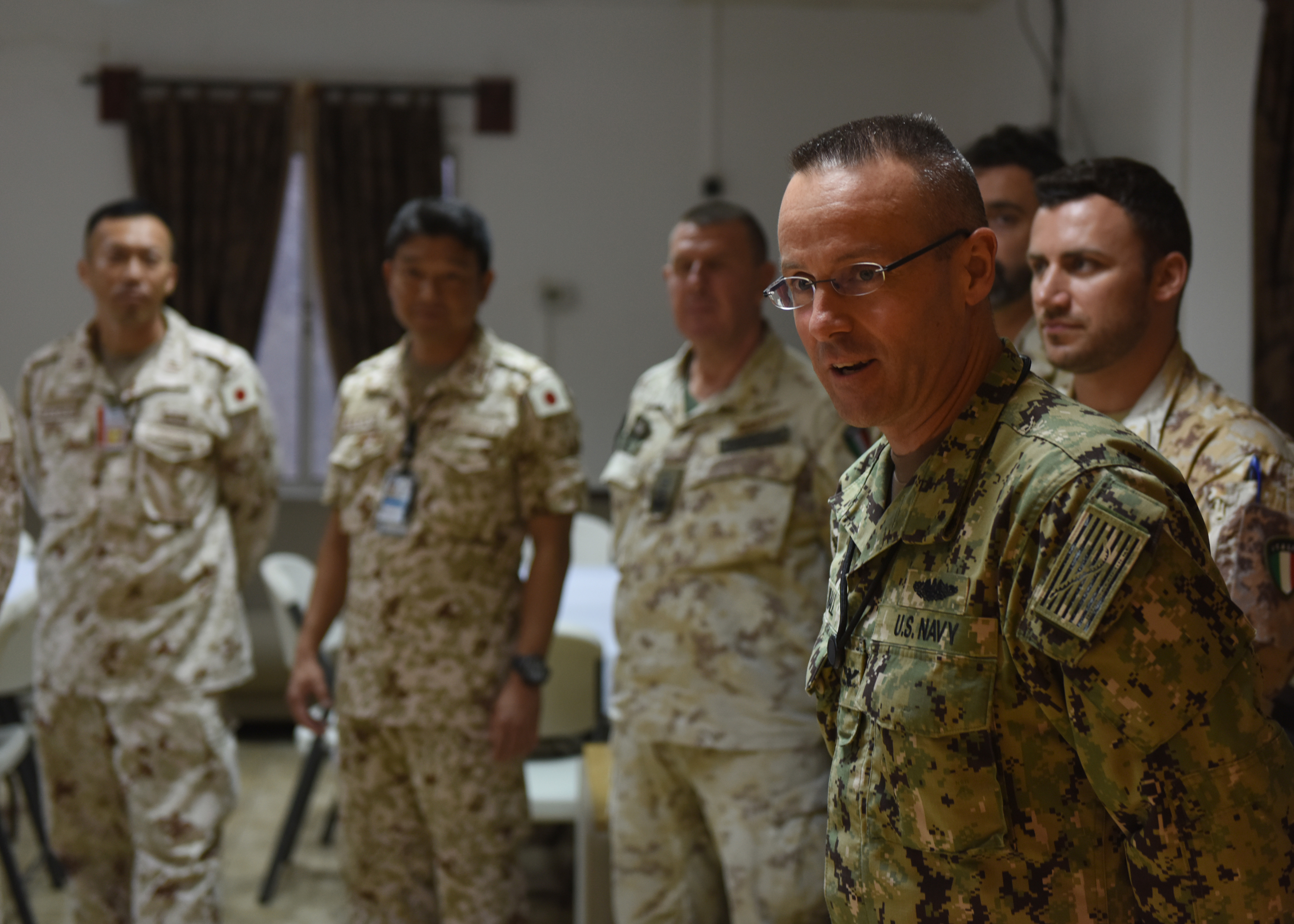 U.S. Navy Capt. Thomas Wall, chief of staff of Combined Joint Task Force-Horn of Africa (CJTF-HOA), bids farewell to multinational military partners during a CJTF-HOA cultural exchange event at Camp Lemonnier, Djibouti, April 24, 2019. CJTF-HOA holds monthly exchange events with multinational military partners affiliated with Camp Lemonnier to strengthen alliances and attract new partners in the combined joint military environment. (U.S. Air Force Photo by Staff Sgt. Franklin R. Ramos)
