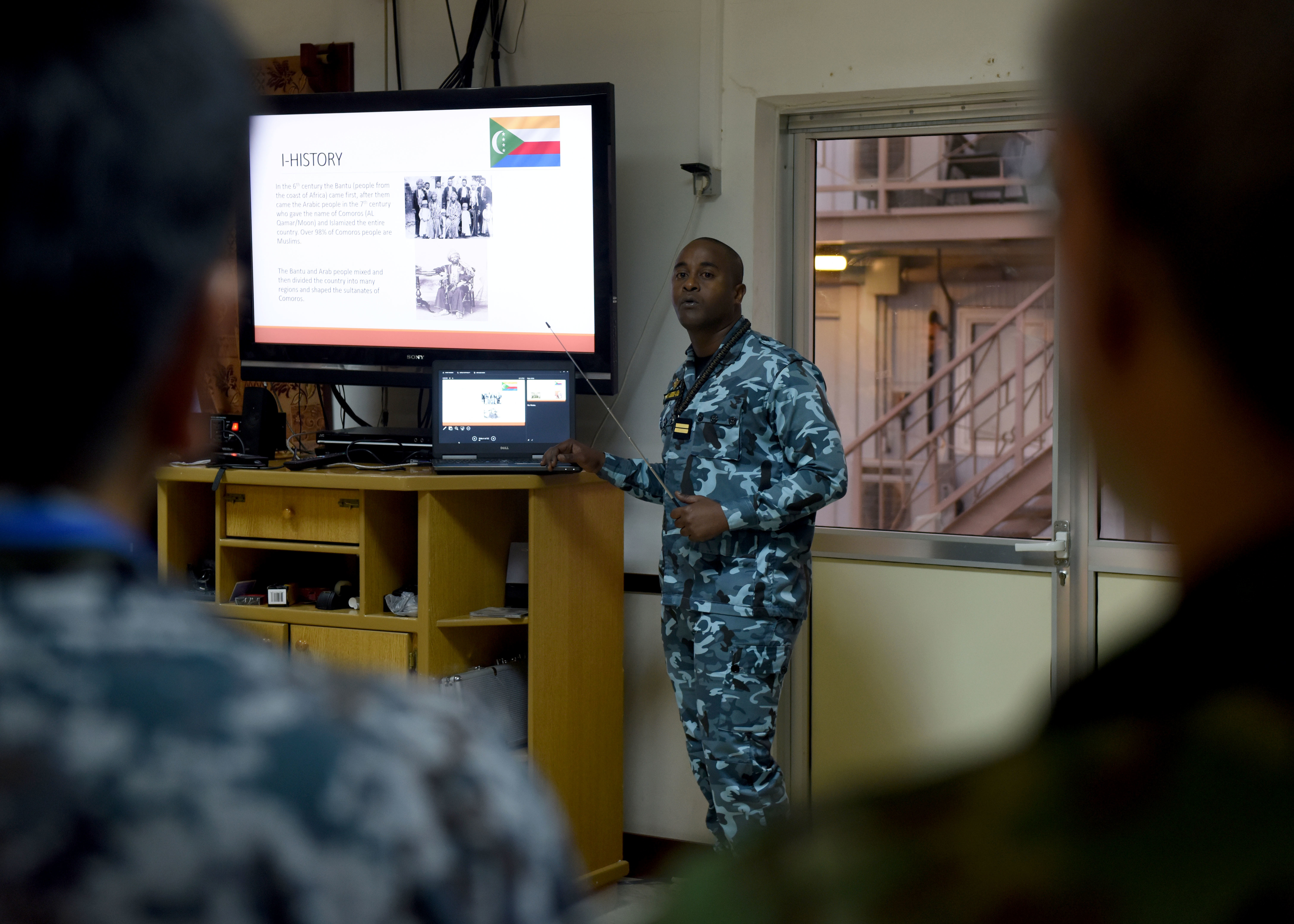 Comoros army Lt. Ali Abdoul-Kader, a foreign liaison officer for Combined Joint Task Force-Horn of Africa (CJTF-HOA), briefs multinational military partners about his country during a CJTF-HOA cultural exchange event at Camp Lemonnier, Djibouti, April 24, 2019. CJTF-HOA holds monthly exchange events with multinational military partners affiliated with Camp Lemonnier to strengthen alliances and attract new partners in the combined joint military environment. (U.S. Air Force Photo by Staff Sgt. Franklin R. Ramos)