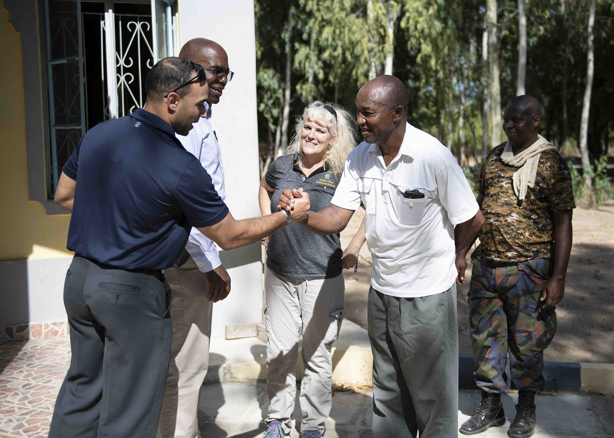 U.S. Army 1st Lt. Luis Alvarez, a Massachusetts National Guard chaplain candidate, shakes hands with Kenya Navy Service Warrant Officer (Rev.) John Mutia Syanda, a senior chaplain at Kenya Navy Compound Manda Bay, while visiting Kenya April 26, 2019. Alvarez and U.S. Army Col. Paul Minor, the senior chaplain assigned to the Massachusetts National Guard, visited Soldiers deployed to Combined Joint Task Force-Horn of Africa and visited Kenya, which is Massachusetts' assigned country under the State Partnership Program, April 25-28, 2019. (U.S. Air Force photo by Tech. Sgt. Shawn Nickel)