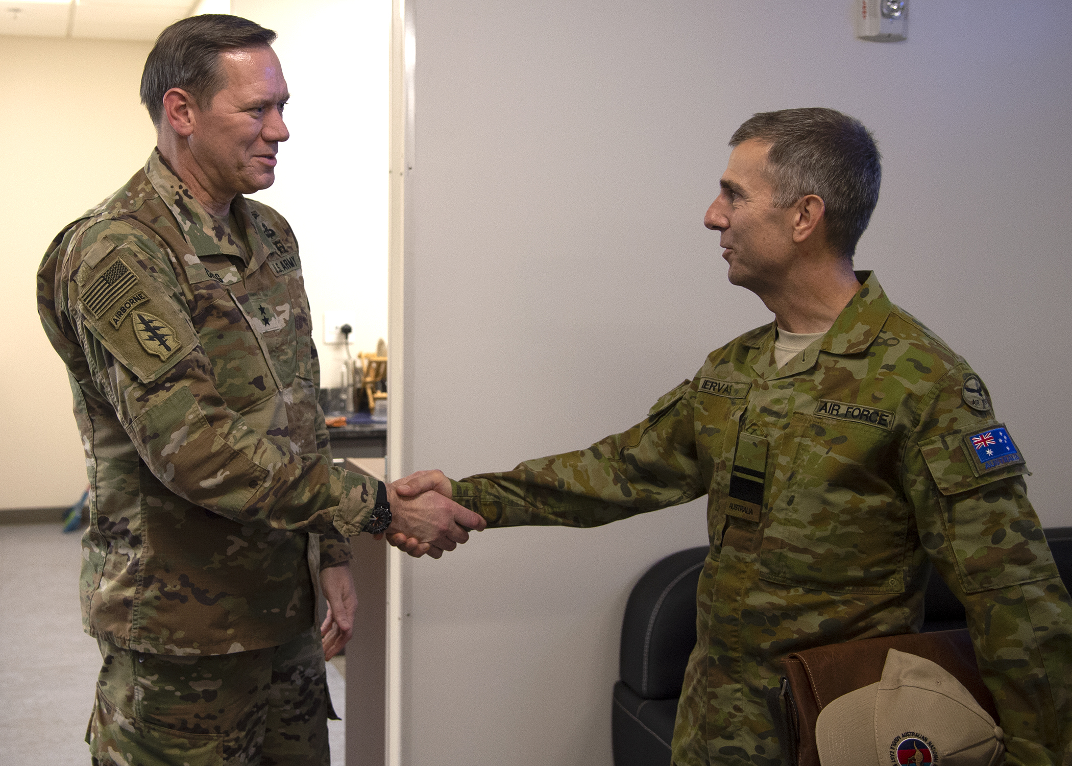 U.S. Army Maj. Gen. James D. Craig, left, commanding general, Combined Joint Task Force-Horn of Africa (CJTF-HOA), shakes hands with Royal Australian air force Air Vice-Marshal Vincent Iervasi as he arrives at Combined Joint Task Force-Horn of Africa (CJTF-HOA), Camp Lemonnier, Djibouti, May 7, 2019. Iervasi visited CJTF-HOA to discuss the continued partnership in Africa between Australia and the United States. (U.S. Navy photo by Mass Communication Specialist 1st Class Nick Scott)