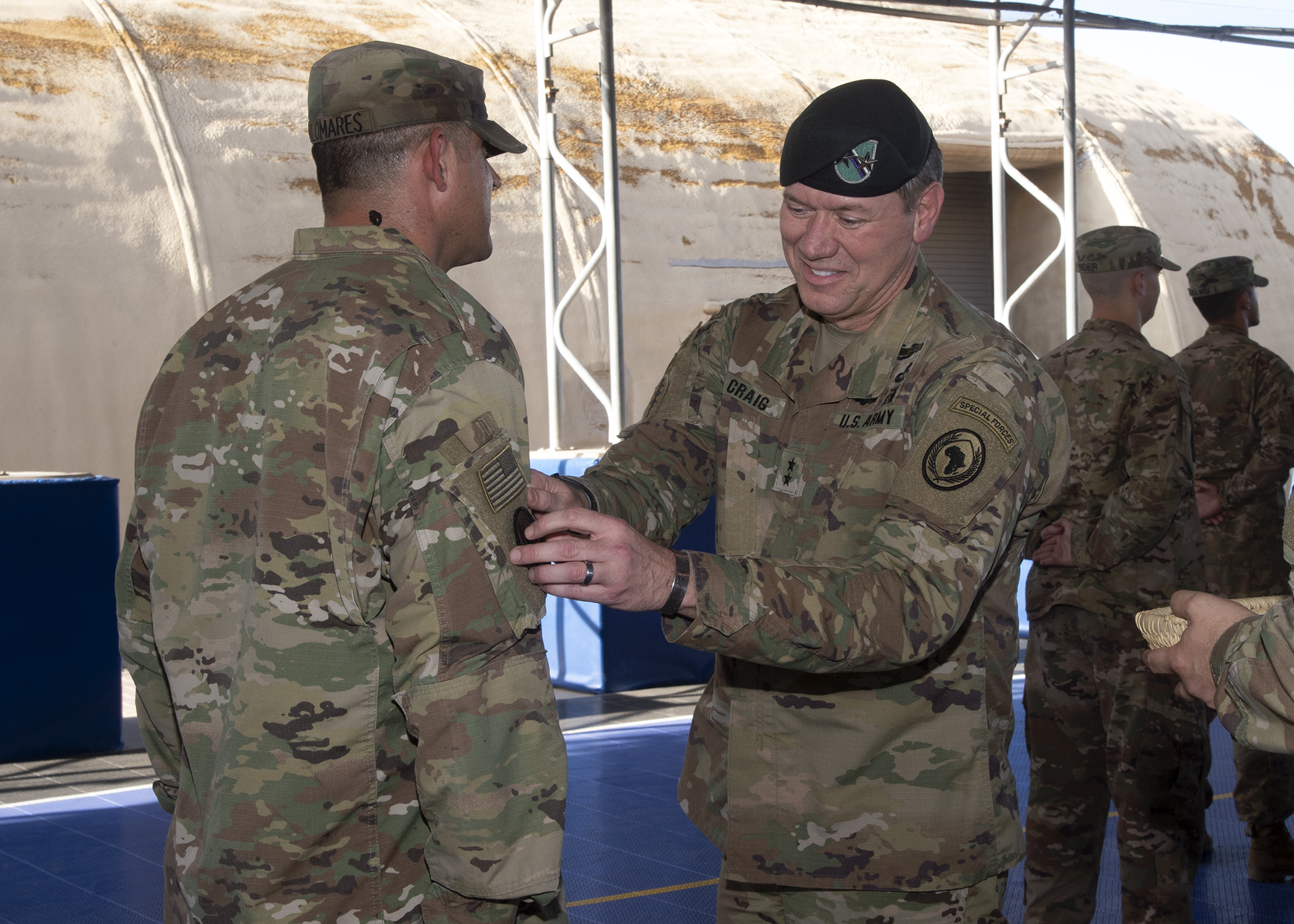 U.S. Army Maj. Gen. James D. Craig, right, commanding general, Combined Joint Task Force-Horn of Africa (CJTF-HOA), presents U.S. Army Master Sgt. Eduardo Palomares a combat patch during a patching ceremony for U.S. Army Soldiers assigned to CJTF-HOA, at Camp Lemonnier, Djibouti, May 10, 2019. Army combat patches signify a Soldier's service in a combat zone and represent service in a member's current, or prior, unit. (U.S. Navy photo by Mass Communication Specialist 1st Class Nick Scott)