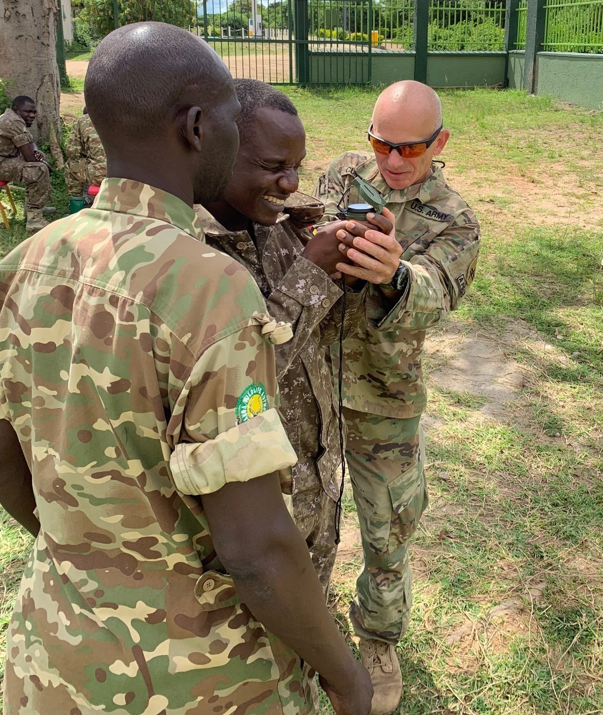 U.S. Army Master Sgt. James Cummings, a 403rd Civil Affairs Battalion Soldier assigned to Combined Joint Task Force-Horn of Africa (CJTF-HOA), assists African coalition partners during a navigation class in Kampala, Uganda, May 20, 2019. Personnel from the civil affairs battalion, travelled to Uganda to take part in a subject matter expert exchange with coalition forces as part of a Uganda Wildlife Authority counter-illicit trafficking course. (Courtesy photo)