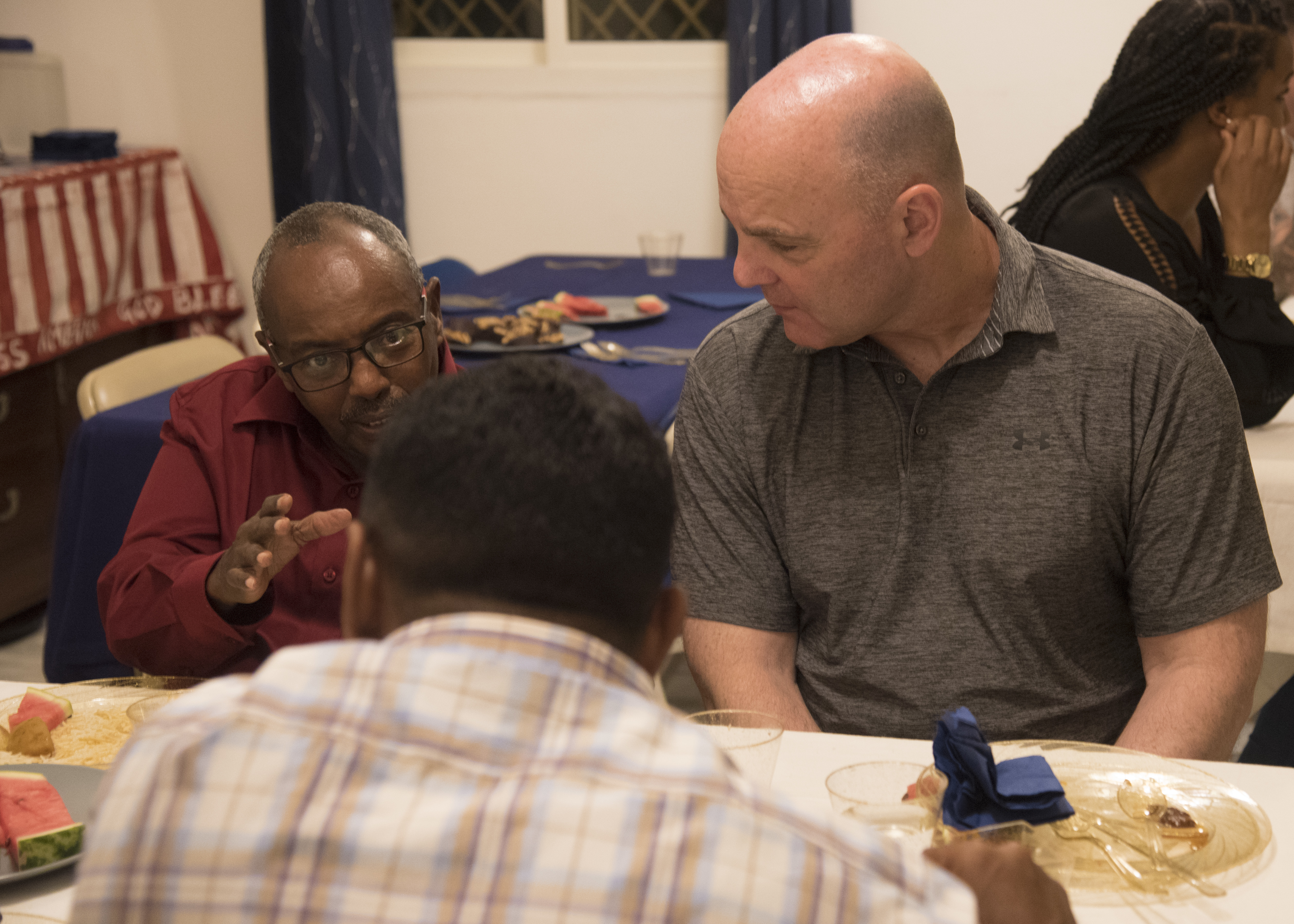 U.S. Air Force Brig. Gen. James R. Kriesel, right, deputy commanding general, Combined Joint Task Force-Horn of Africa, listens to a Djiboutian guest at an Iftar celebration at the home of U.S. Embassy Djibouti's senior defense attaché in Djibouti, May 12, 2019. The Iftar is a fast-breaking meal Muslims eat after sunset during Ramadan, the ninth month of the Islamic year observed with daily fasting from dawn to sunset. (U.S. Air Force photo by Staff Sgt. Kirsten Brandes)