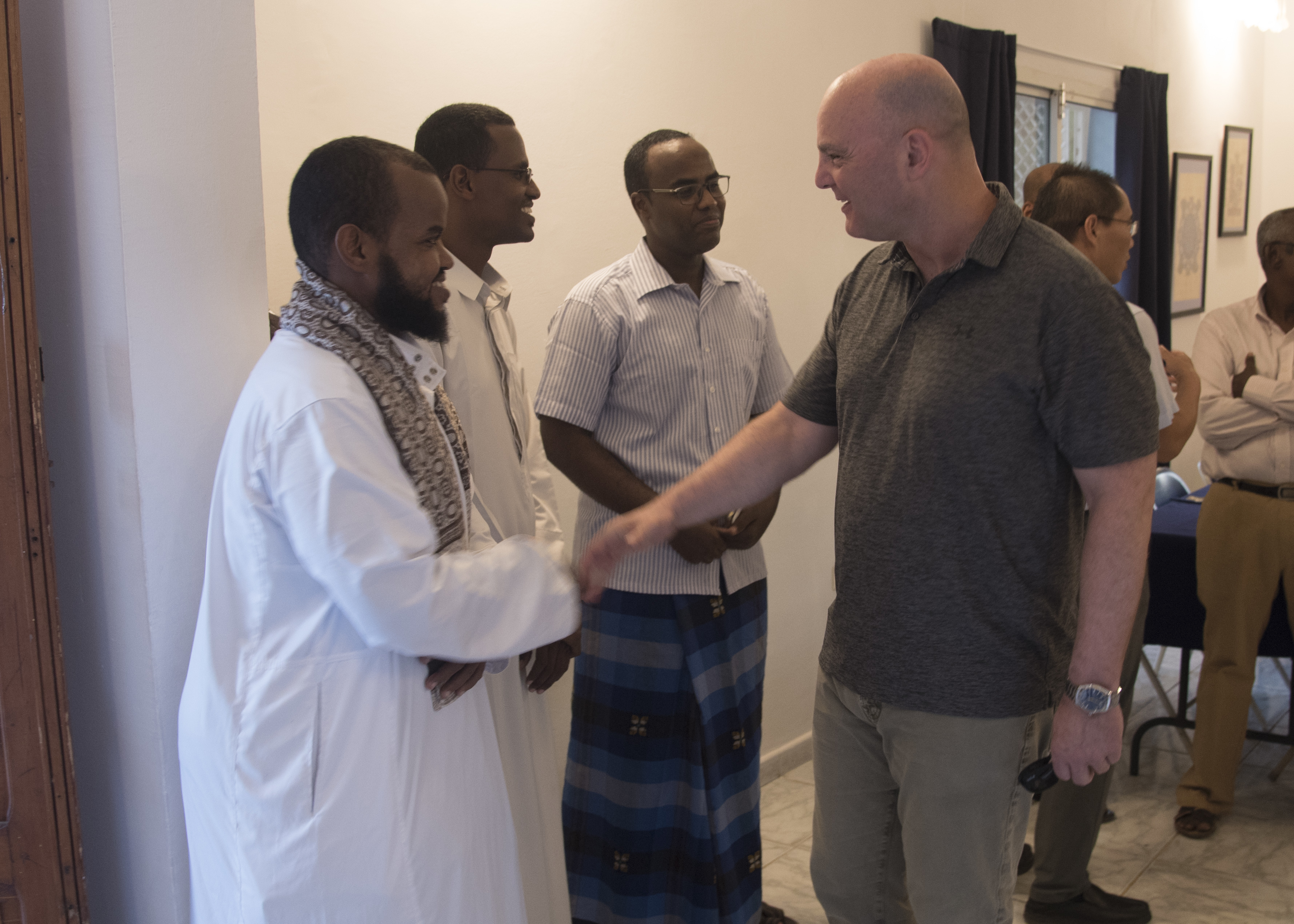 U.S. Air Force Brig. Gen. James R. Kriesel, right, deputy commanding general, Combined Joint Task Force-Horn of Africa, greets a Djiboutian guest at an Iftar celebration at the home of U.S. Embassy Djibouti's senior defense attaché in Djibouti, May 12, 2019. The Iftar is a fast-breaking meal Muslims eat after sunset during Ramadan, the ninth month of the Islamic year observed with daily fasting from dawn to sunset. (U.S. Air Force photo by Staff Sgt. Kirsten Brandes)