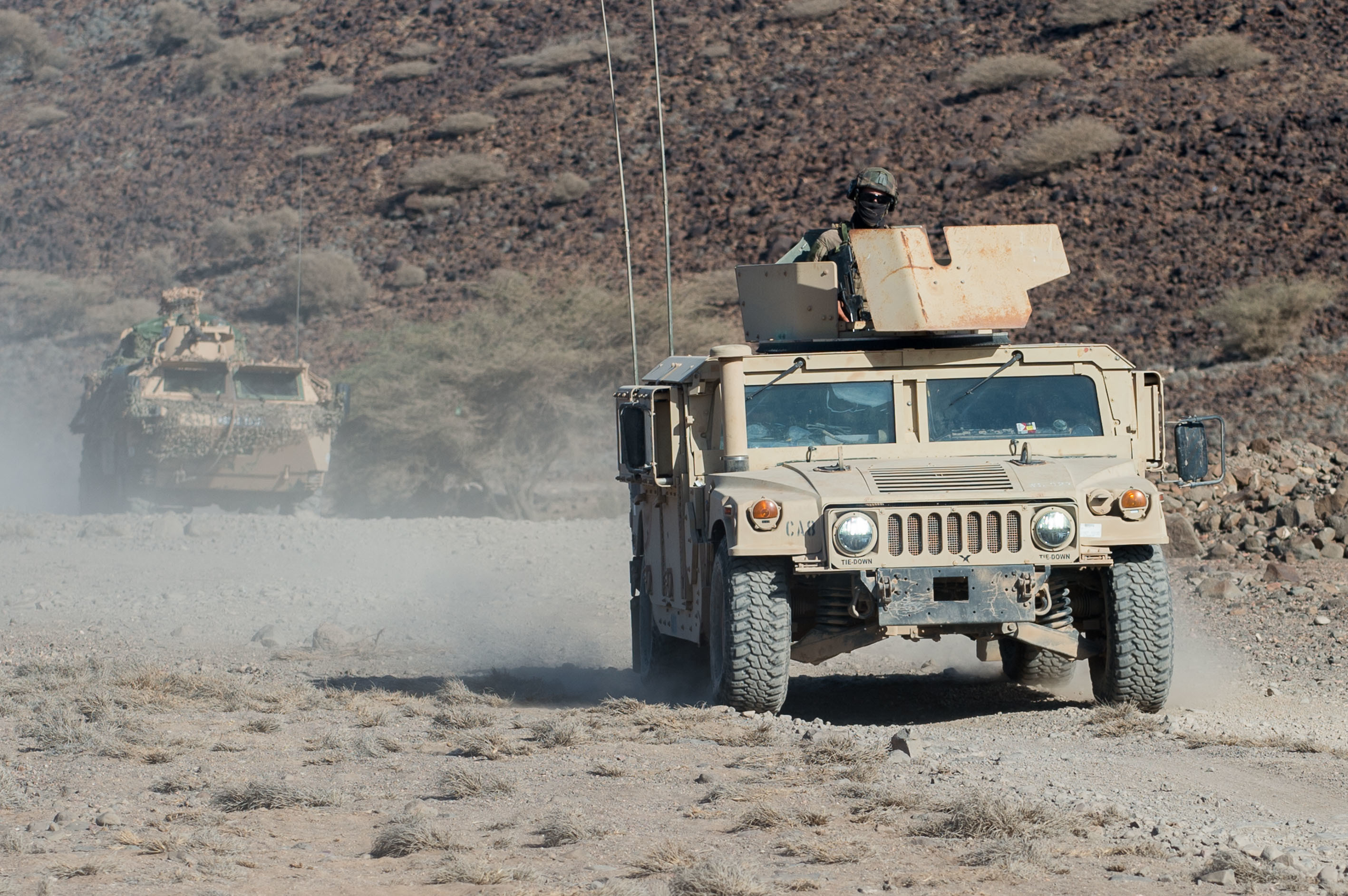 U.S. Army Soldiers assigned to Combined Joint Task Force-Horn of Africa and French army soldiers drive a U.S. Humvee and a French armored vanguard vehicle during a French Desert Commando Course in Arta, Djibouti, May 15, 2019. The six-day course consisted of three exercises lasting two days each in company squad training, platoon squad training and live fire scenarios. (Courtesy Photo)