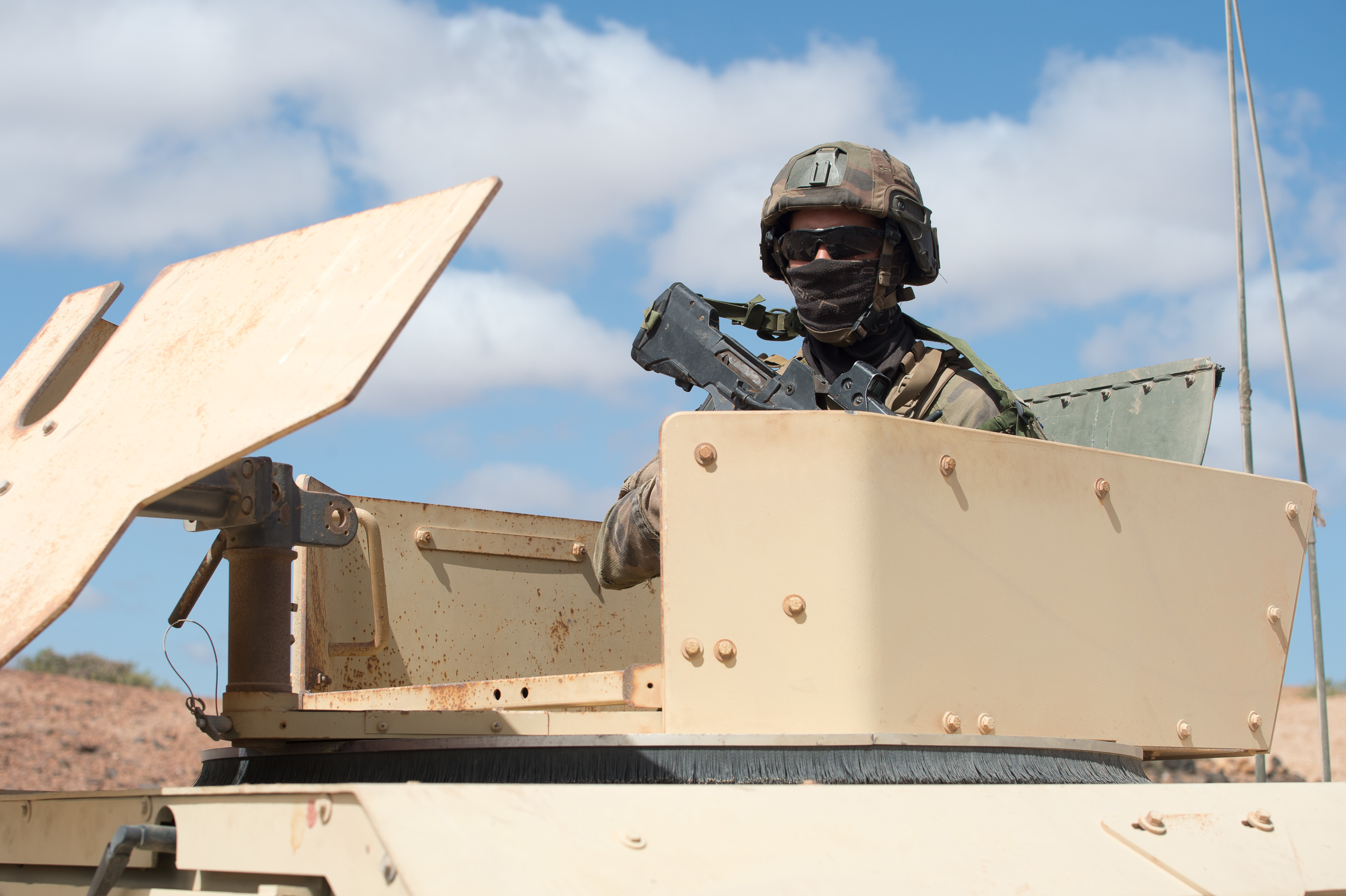 A French army soldier looks out of a U.S. Humvee during a French Desert Commando Course in Arta, Djibouti, May 15, 2019. The course is a premiere French training event designed to develop each soldier's ability to perform mounted missions in a desert environment, and develop individual Soldier mountaineering and water confidence. (Courtesy Photo)