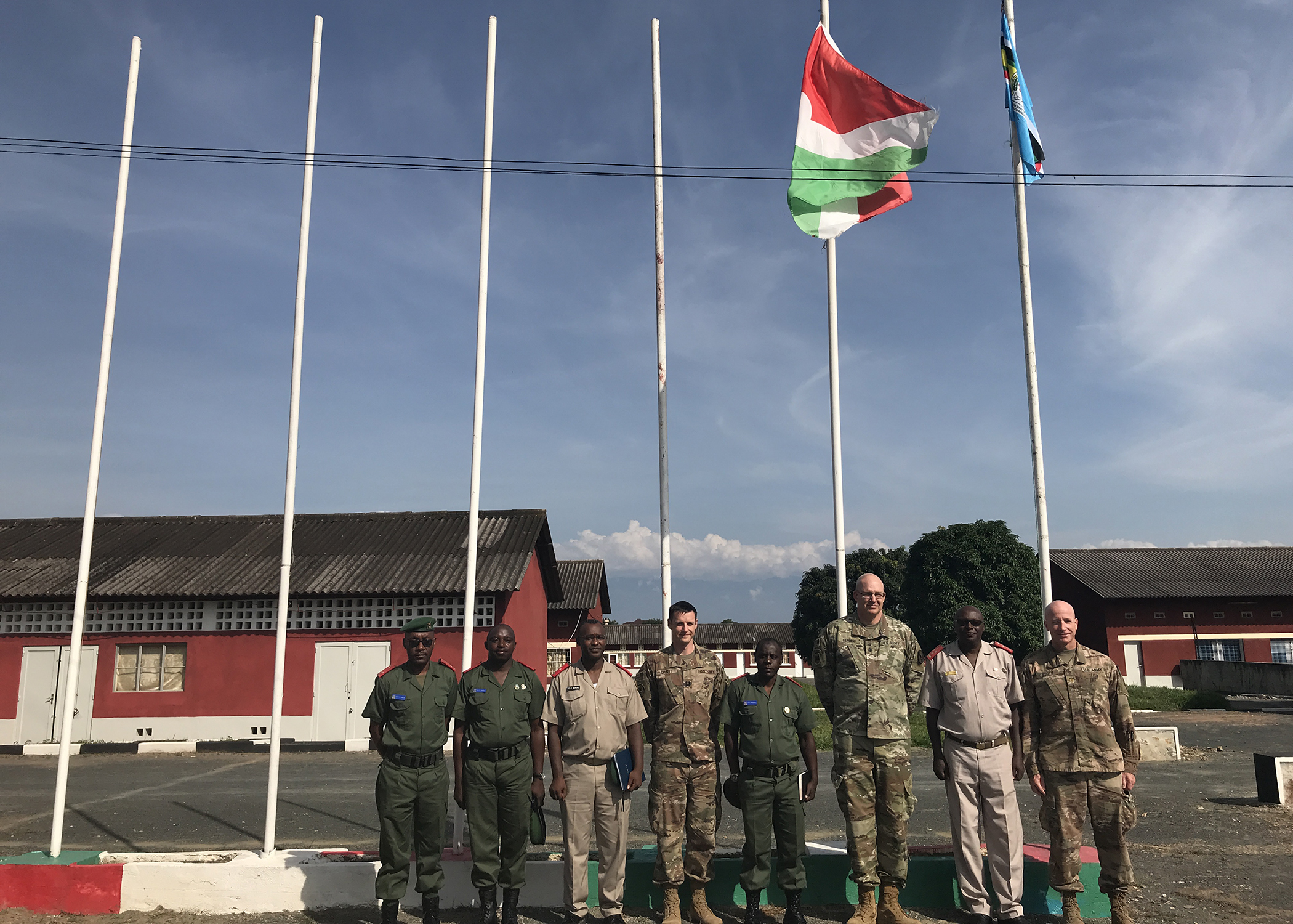 Combined Joint Task Force-Horn of Africa service members pose for a group photo at the Burundi National Defence Force Senior Command and Staff College (SCSC), in Kinanira, Burundi, May 17, 2019.  A team of CJTF-HOA service members visited Burundi to discuss best practices with the Burundi SCSC students. (Courtesy Photo)