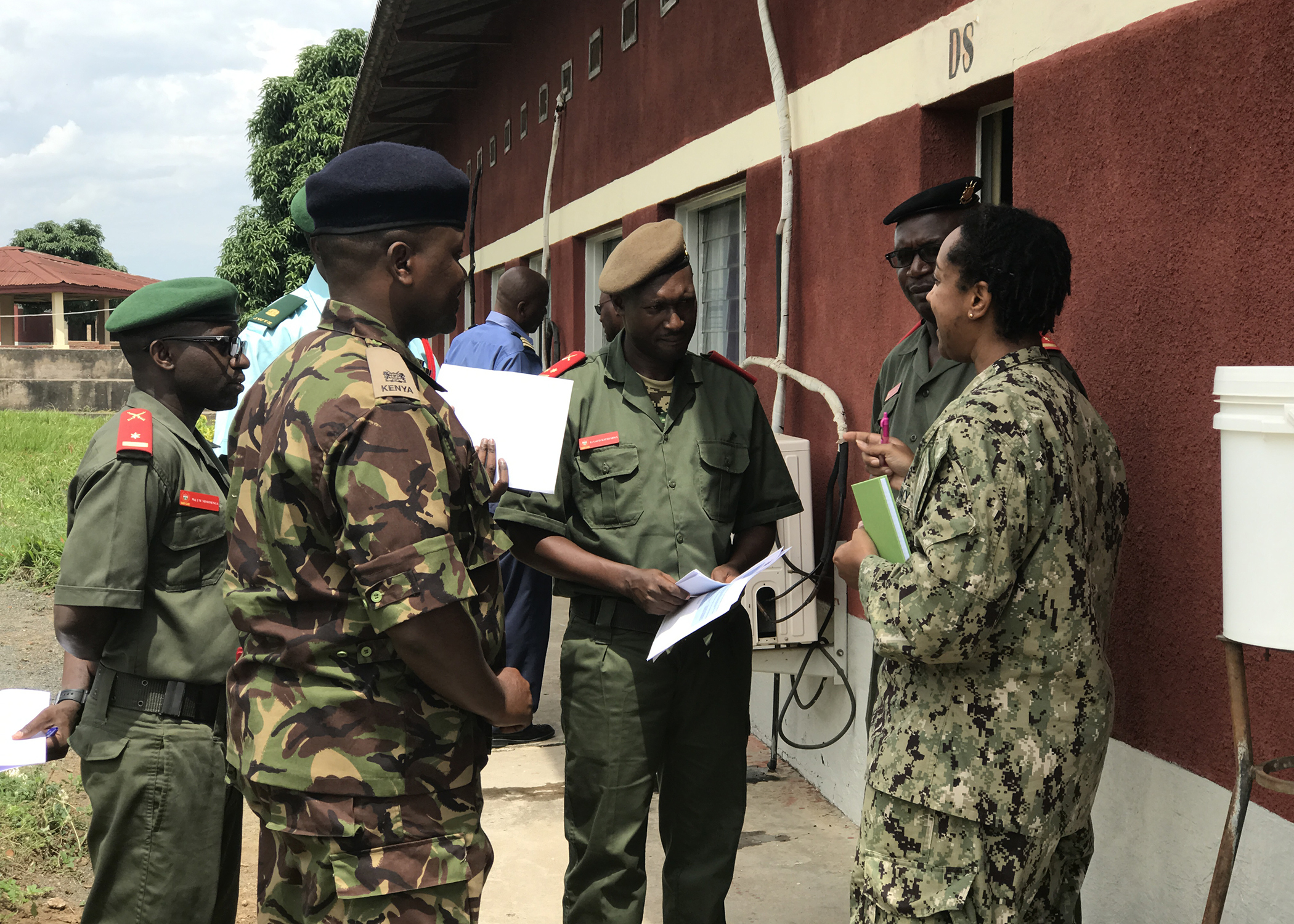 U.S. Navy Cmdr. Charity Hardison, public affairs director, Combined Joint Task Force-Horn of Africa, speaks with Burundi Senior Command and Staff College (SCSC) students during a subject matter expert exchange in Kinanira, Burundi, May 15, 2019.  Hardison was part of a four-person team of CJTF-HOA service members who visited Burundi to discuss best practices with the Burundi SCSC students. (Courtesy Photo)