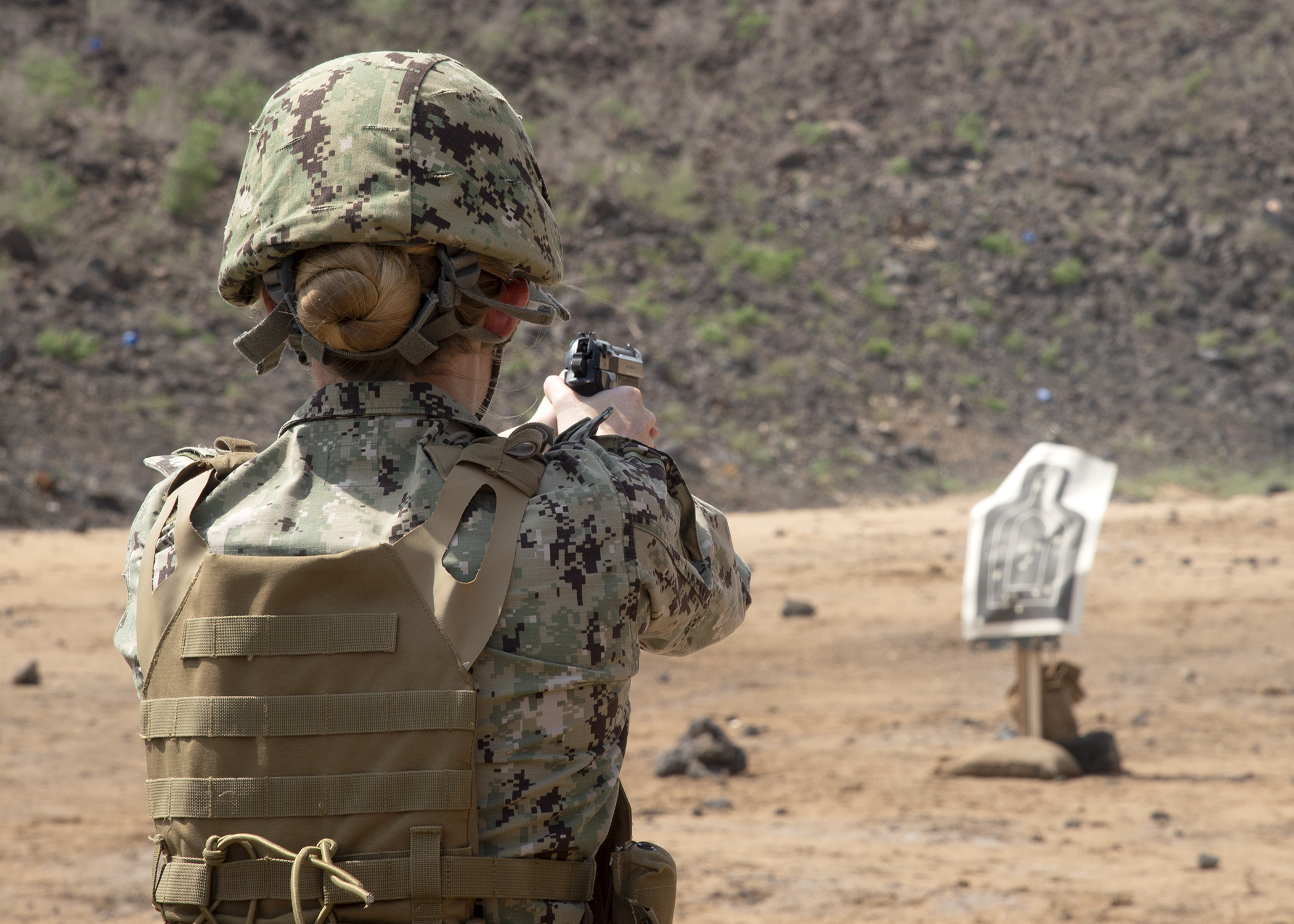 U.S. Navy Petty Officer 2nd Class Sarah Brandt, a master at arms assigned to Camp Lemonnier, Djibouti, fires an M-9 pistol during the marksmanship portion of the German Armed Forces Badge for military proficiency, at the Arta Range Complex, Djibouti, June 12, 2019. Competing for the badge offered a unique opportunity for joint personnel from Combined Joint Task Force-Horn of Africa and Camp Lemonnier, and also works as an information exchange between the U.S. and German militaries. (U.S. Navy photo by Mass Communication Specialist 1st Class Nick Scott)