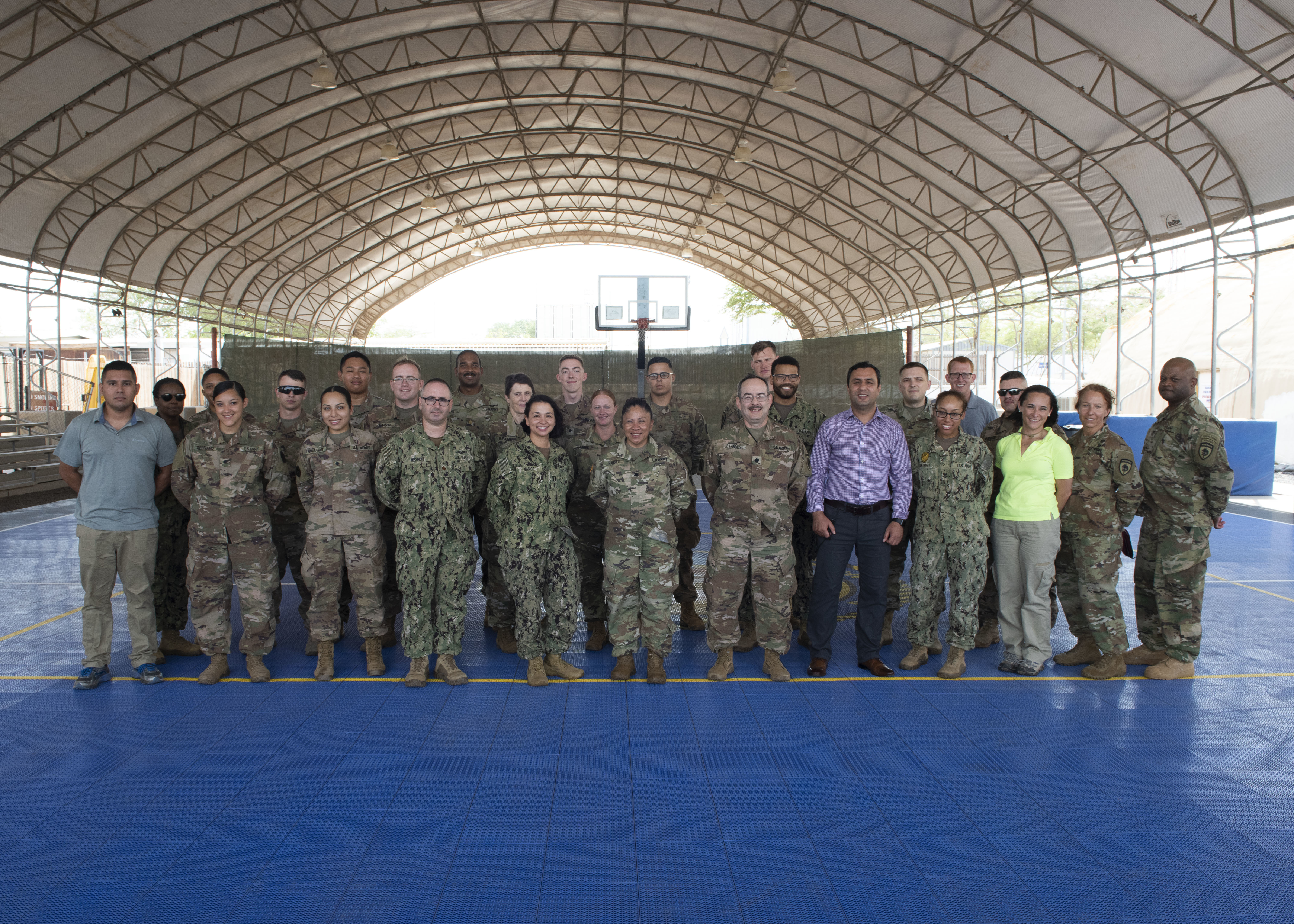 Members from Combined Joint Task Force-Horn of Africa (CJTF-HOA) and the Center for Global Health Engagement, Uniformed Services University, Maryland, pose for a photo during a Fundamentals of Global Health Engagement (FOGHE) course at Camp Lemonnier, Djibouti, June 11, 2019. The FOGHE is a three-day course to improve understanding of the full array of issues surrounding and shaping global health engagements. (U.S. Air Force photo by Staff Sgt. Franklin R. Ramos)