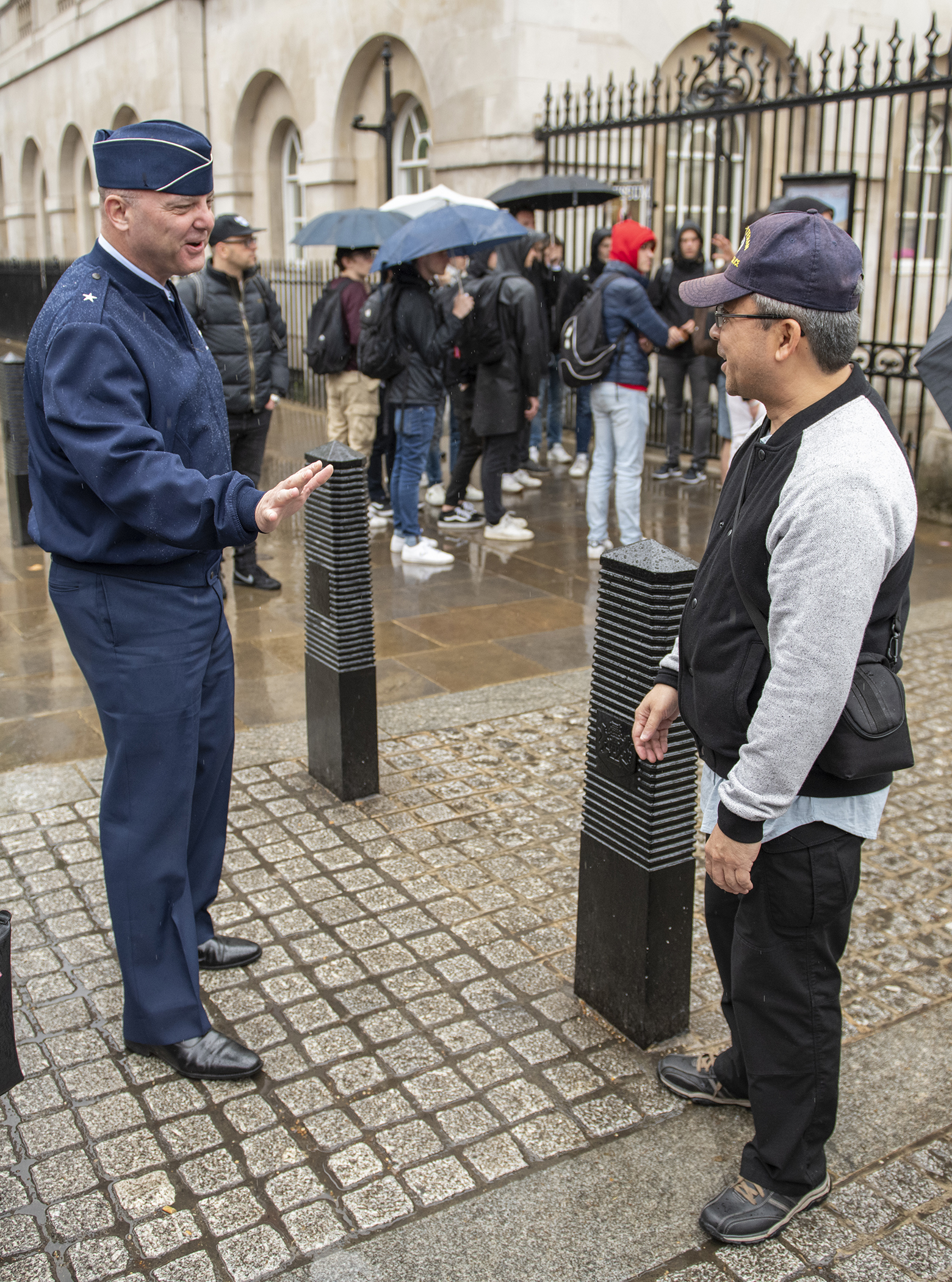 U.S. Air Force Brig. Gen. James R. Kriesel, deputy commanding general of Combined Joint Task Force-Horn of Africa, left, stops to thank a vacationing U.S. Air Force veteran for his service while walking near 10th Downing Street in London, June 7, 2019. Kriesel visited the U.K. to build relations with leaders across the Ministry of Defense and familiarize himself with the partner nation's information exchange policies, which is mission essential in support of national objectives. (U.S. Air Force photo by Tech. Sgt. Shawn Nickel)